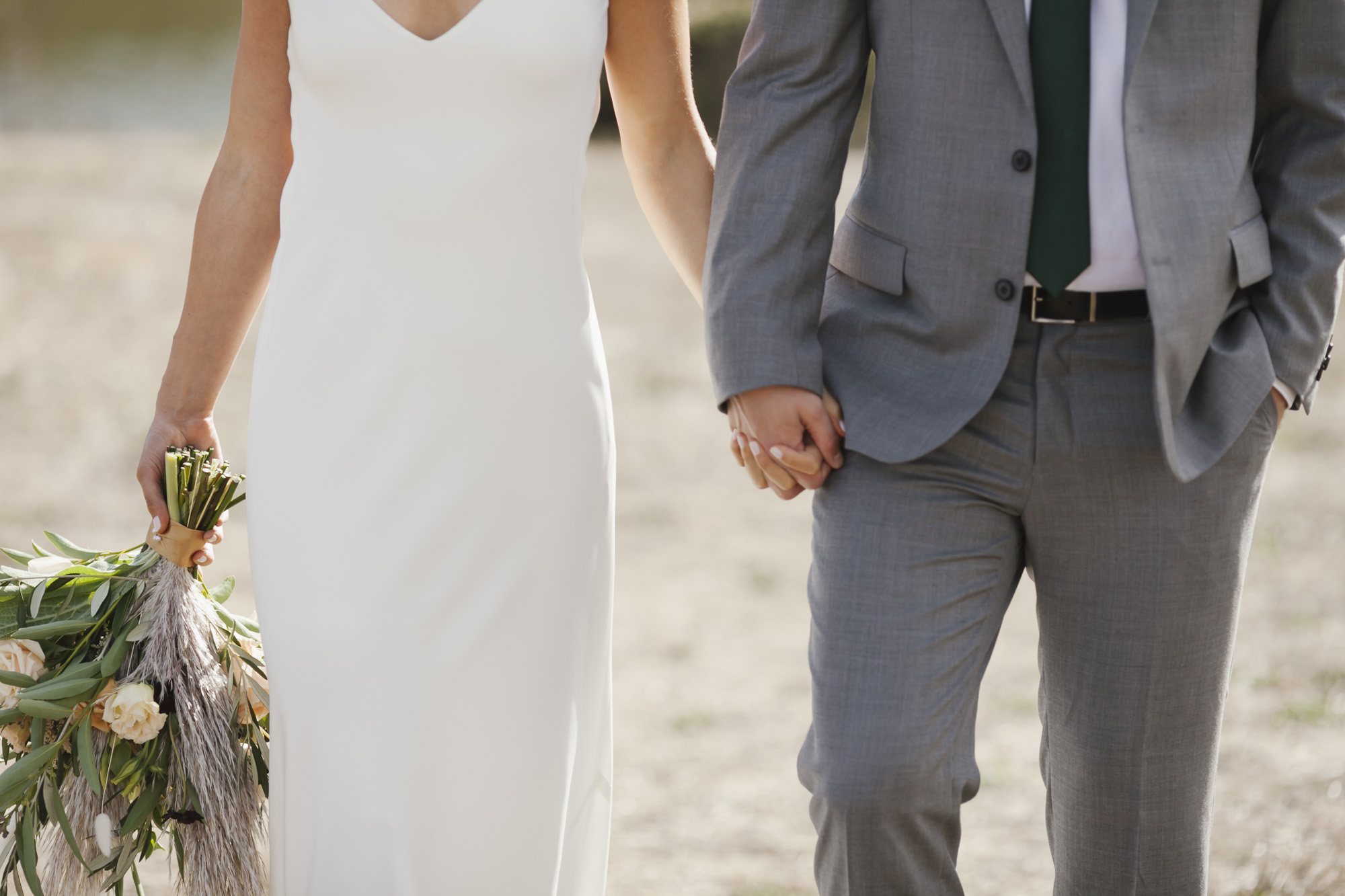 Bride and groom hold hands in the Marin Headlands