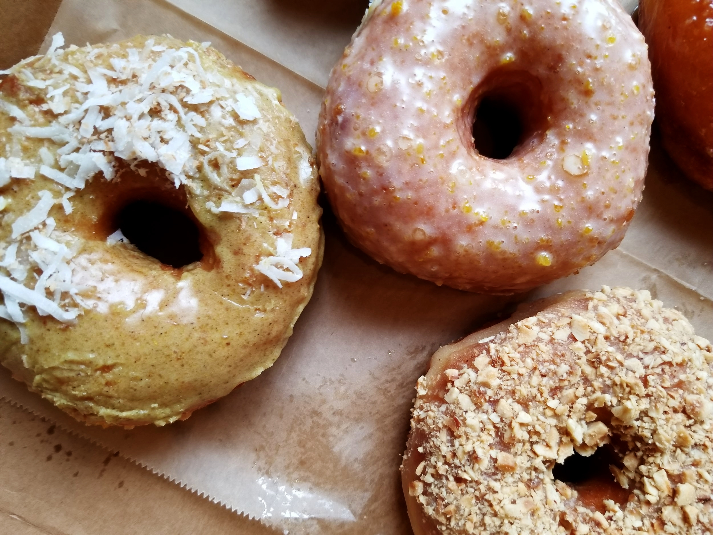 Coconut curry, citrus glazed, and hazelnut covered doughnut were just a few of the doughnuts we sampled.