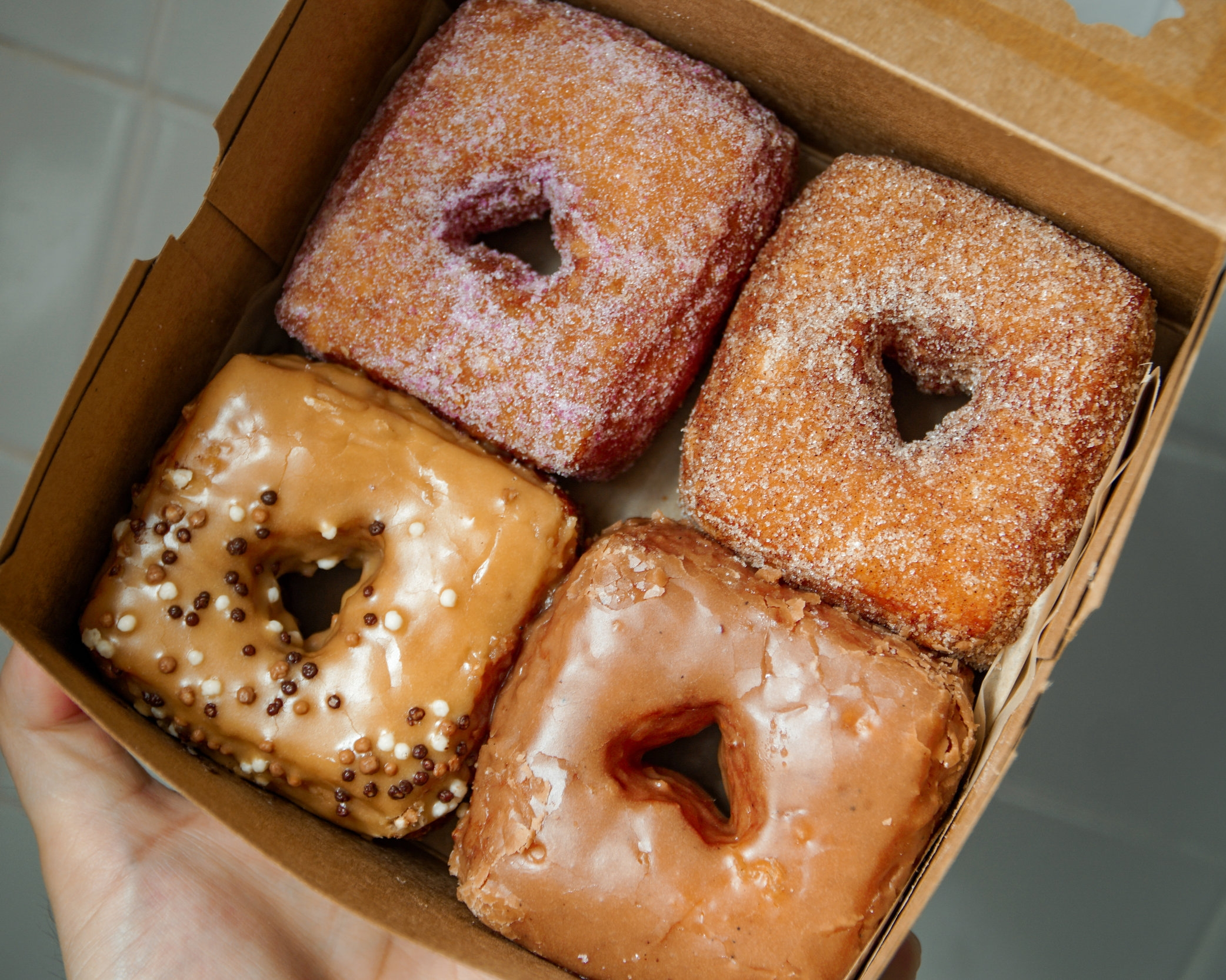 Stamped with love, these brioche dough babies are keeping Chicago's doughnut scene alive.