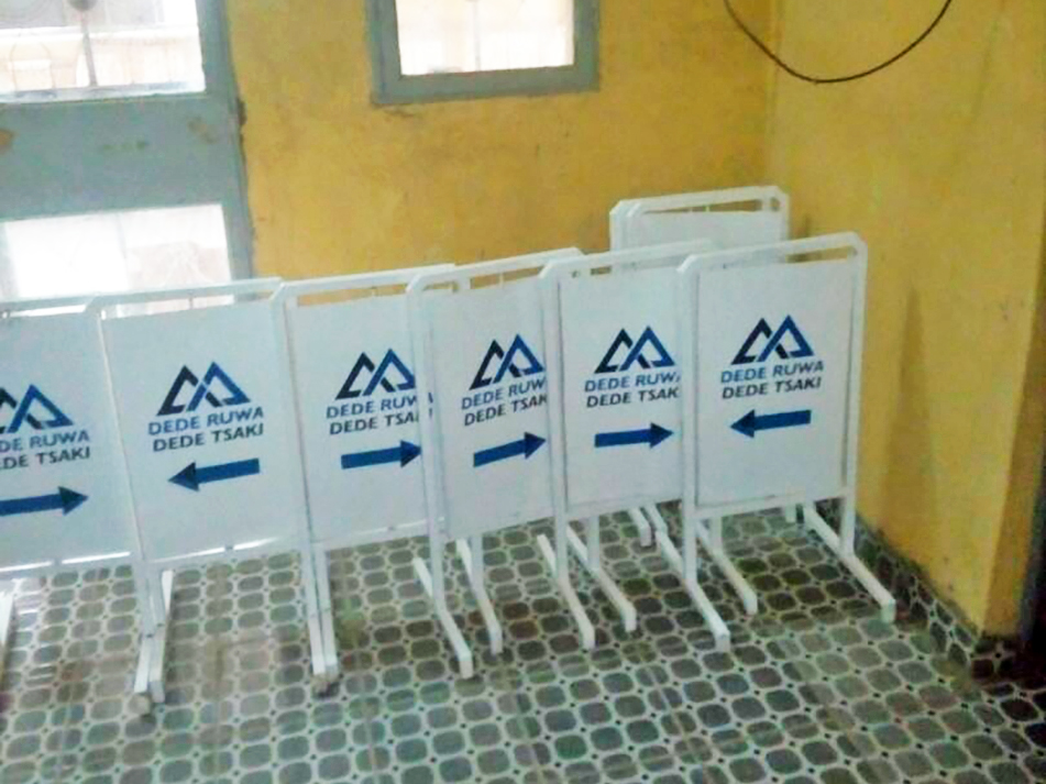 Freshly painted signs for Dede Ruwa Dede Tsaki to be given to participating fadas across implementing villages