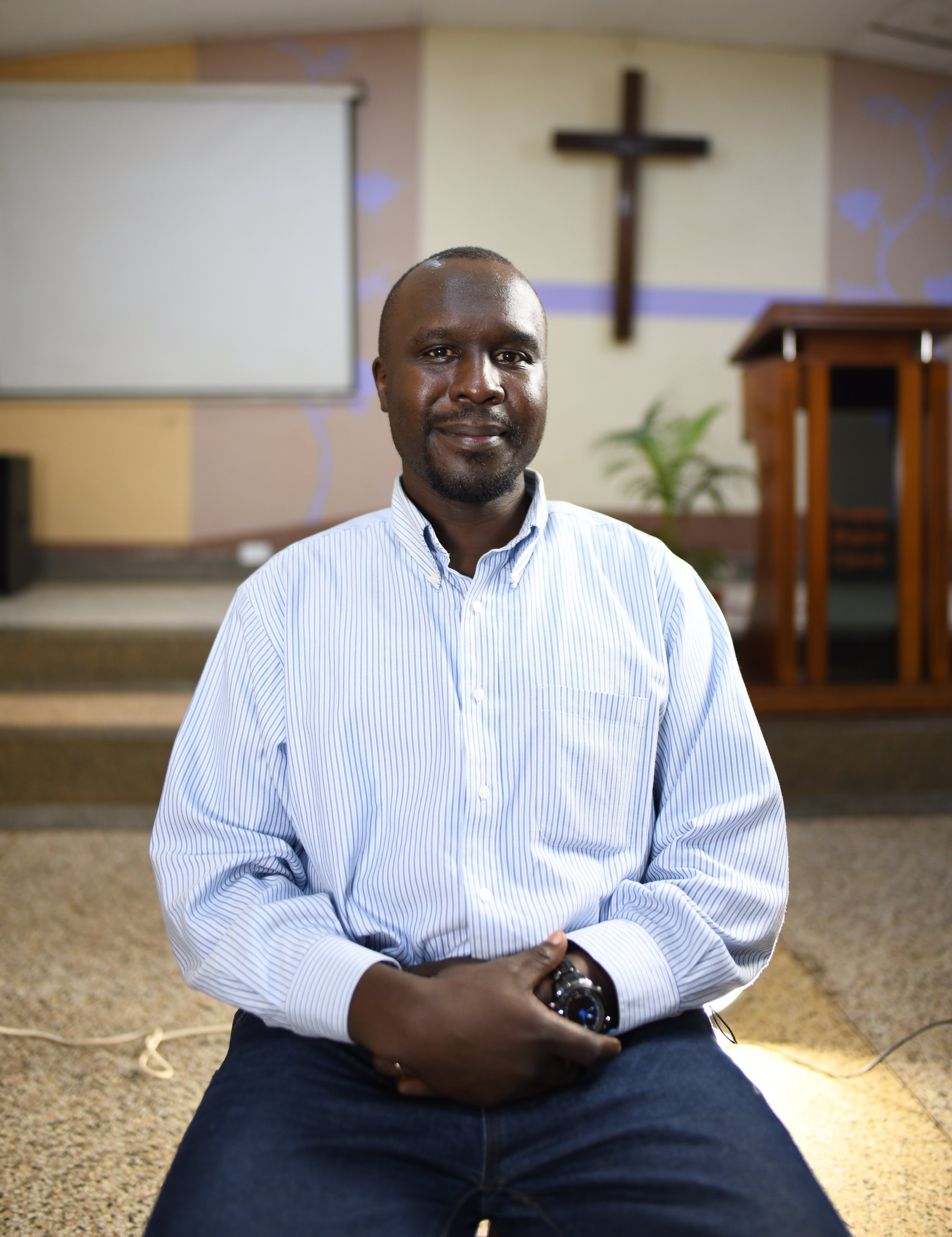 Dennis Kilama - Kampala, UgandaDennis Kilama is my name, I am married to Yvonne Nabwire Kilama. God has blessed us with two children. Kimara (7 years) and Kigen (4 years). We have been married for the past 10 years.My call to ministry was one step at a time, one day at a time. First as a Social Work student at Makerere University, then later as a seminary student at Nairobi Evangelical School of Theology and a call to ordination in the Baptist Church.For the past eight years, I have served as the Pastor of Lugogo Baptist Church, a church in the city of Kampala. Kampala is a fast growing city with great opportunities for planting bible believing, bible teaching churches. As a local church family we are involved in several church planting initiatives and are currently in the midst of planting a church in an area with a fast growing population sandwiched between the two largest Muslim communities around the city.