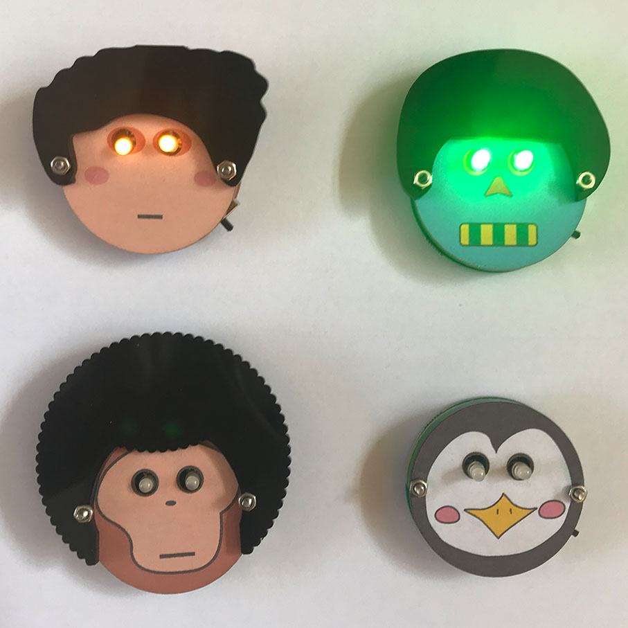 人面拼砌 Face ID (Character Face ID)    語言 Language:  廣東話   時段 Time:   1. 12:00pm - 1:00pm  學習簡易電路,設計個人卡通頭像襟章,配合LED,令襟章發光。   Learn simple circuitry and make your own character light-up pin!