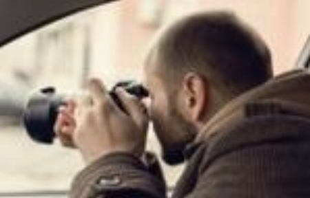 stock-photo-investigator-or-private-detective-or-reporter-or-paparazzi-sitting-in-car-and-taking-photo-with-1009943569.jpg