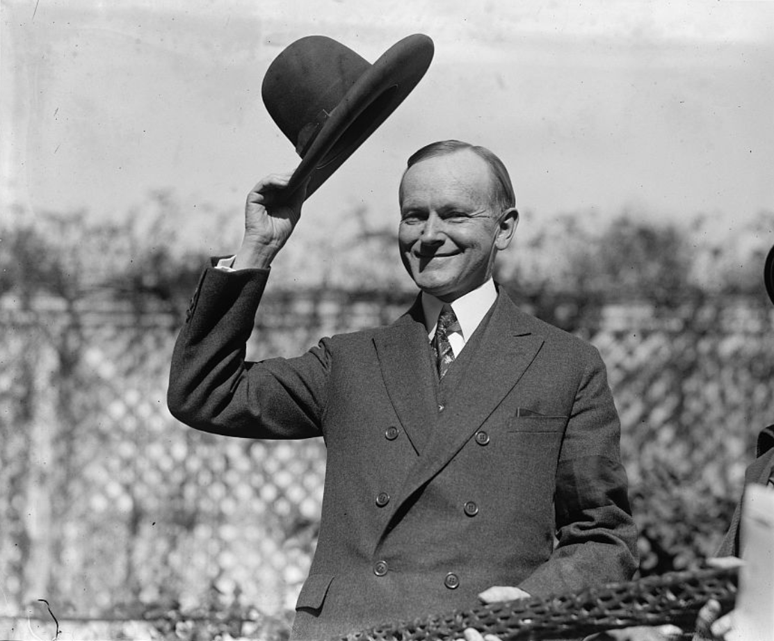 American President Coolidge with hat presented by Amoki Tribe (1924).png