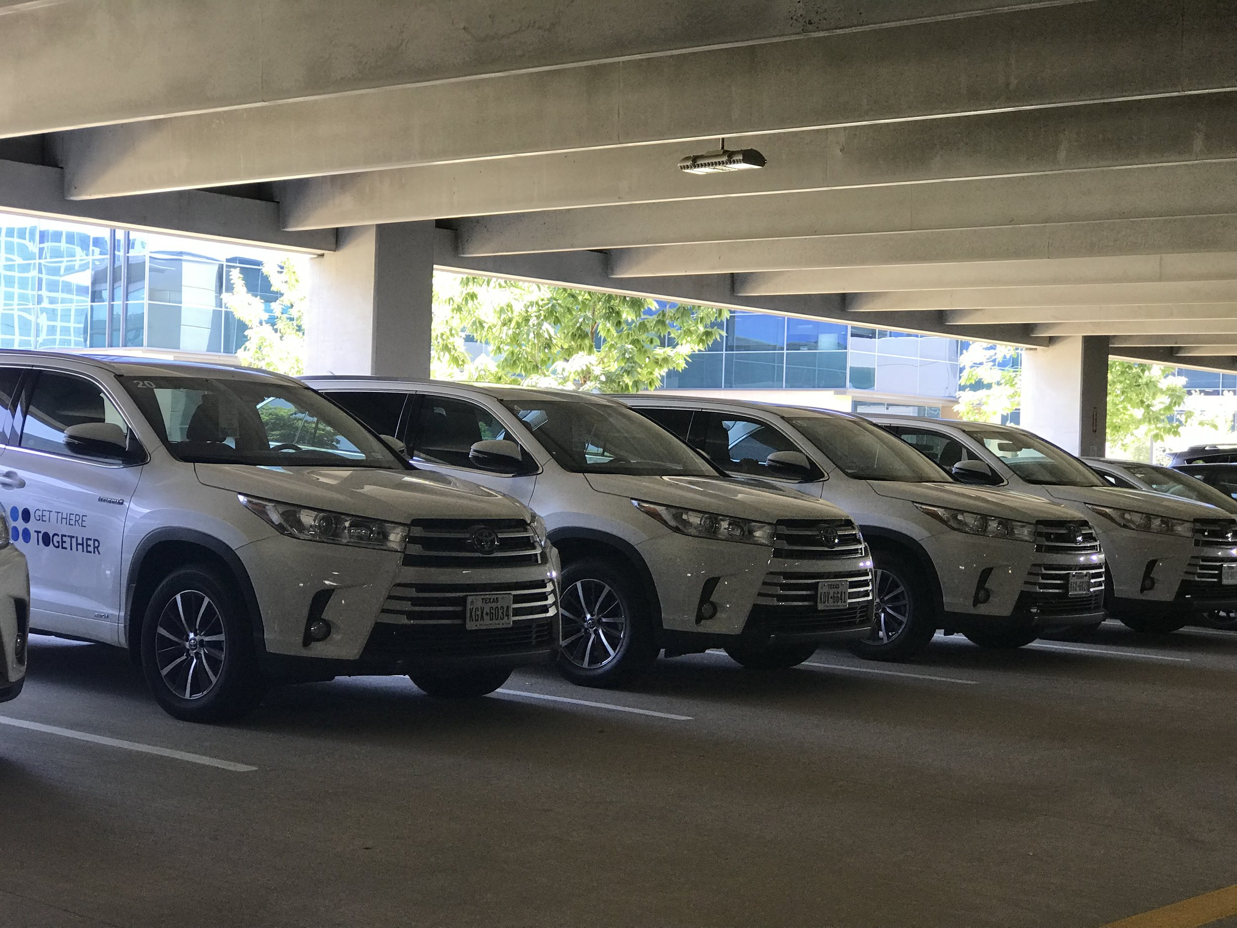 Hybrid Highlanders from the  Carma Share  fleet lining the walls of the Toyota parking garage.