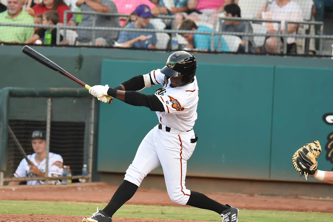 Eric Jenkins of the Down East Wood Ducks swings during Friday's 5-3 victory against the Potomac Nationals at Historic Grainger Stadium. The outfielder scored once and walked once in the victory.