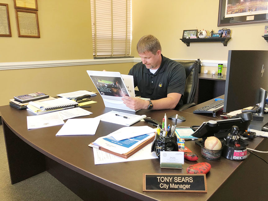 Kinston City Manager Tony Sears looks over the 2018-19 budget at City Hall last week. Photo by Bryan Hanks / Neuse News