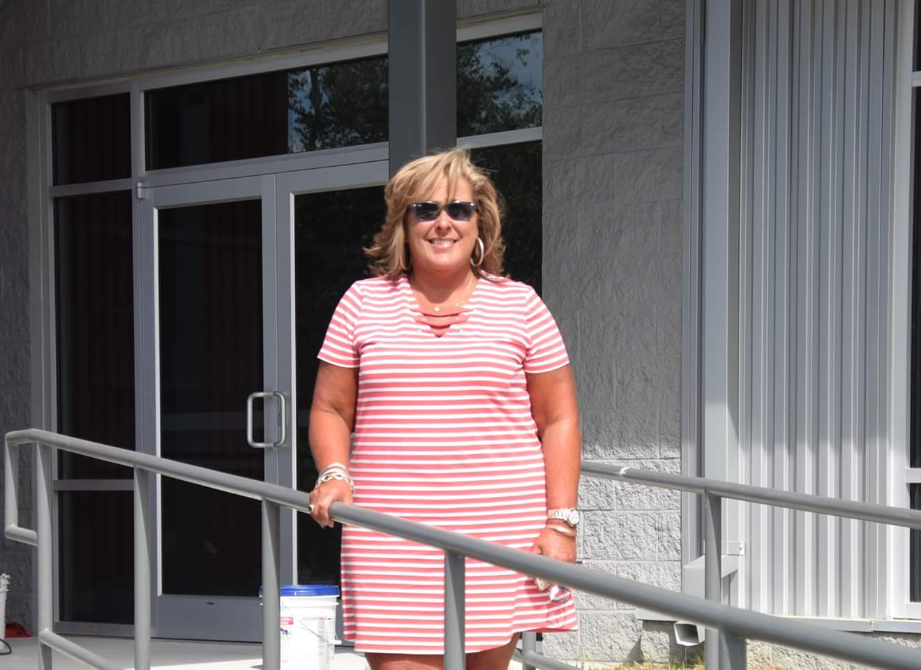 """Tammy Kelly, Lenoir County Cooperative Extension Director, poses at the front of the rebuilt office. Photo by William 'Bud"""" Hardy / Neuse News"""