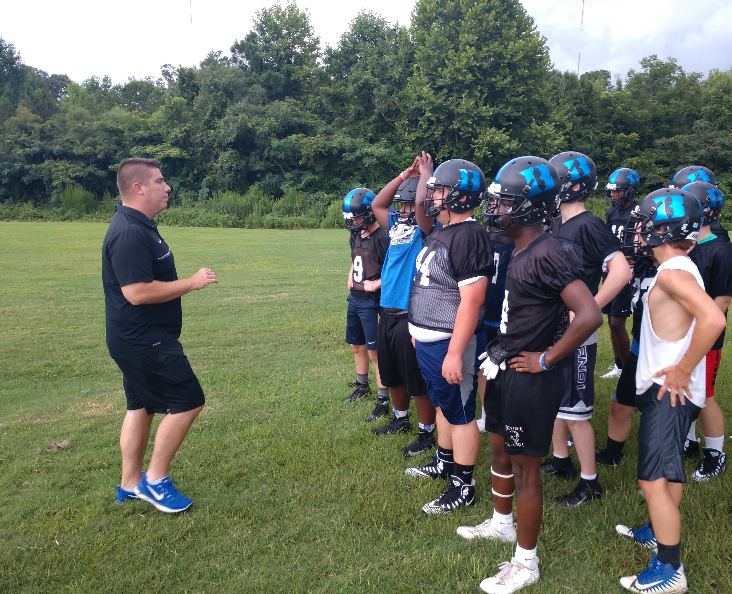 Bethel Christian coach Brick Crowder addresses the team during Monday's practice. Photo by Junious Smith III / Neuse News