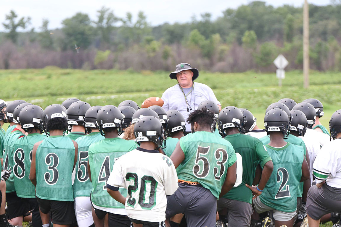 North Lenoir football coach Jim Collins talks to his team during Monday's practice. Photo by William 'Bud' Hardy