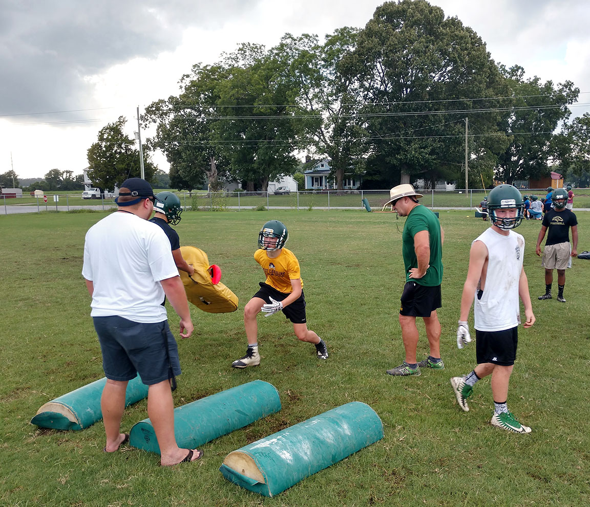 Members of Ayden-Grifton's football team go through drills during Tuesday's practice. Photo by Junious Smith III / Neuse News