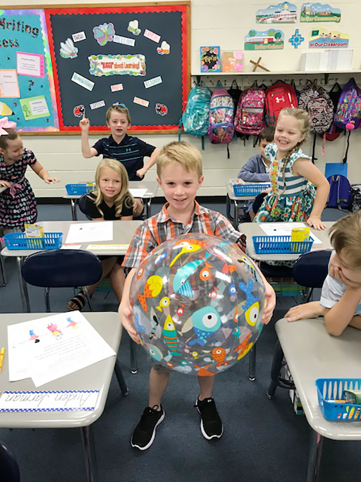 Ayden Jarman plays an introduction game in Karen Daniels' second-grade classroom at Bethel Christian Academy.