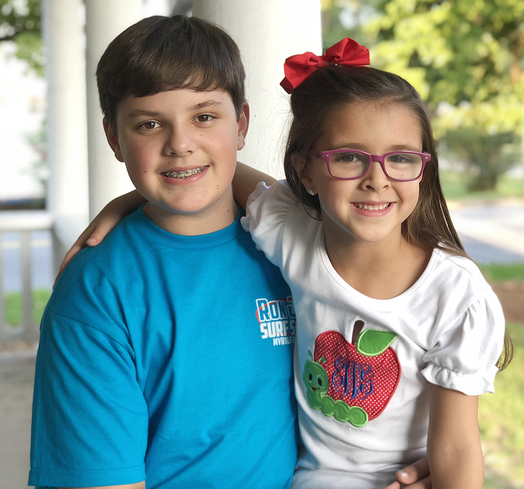 Turner White, left, eighth grade, Woodington Middle School; Ella Grace White, first grade, Pink Hill Elementary School