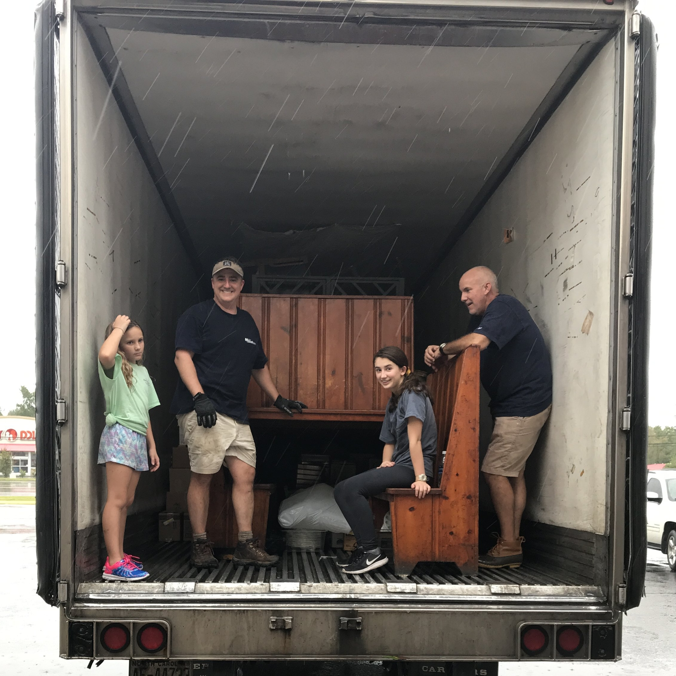 APA students help adults move furniture from King's Restaurant before the Neuse River crested.
