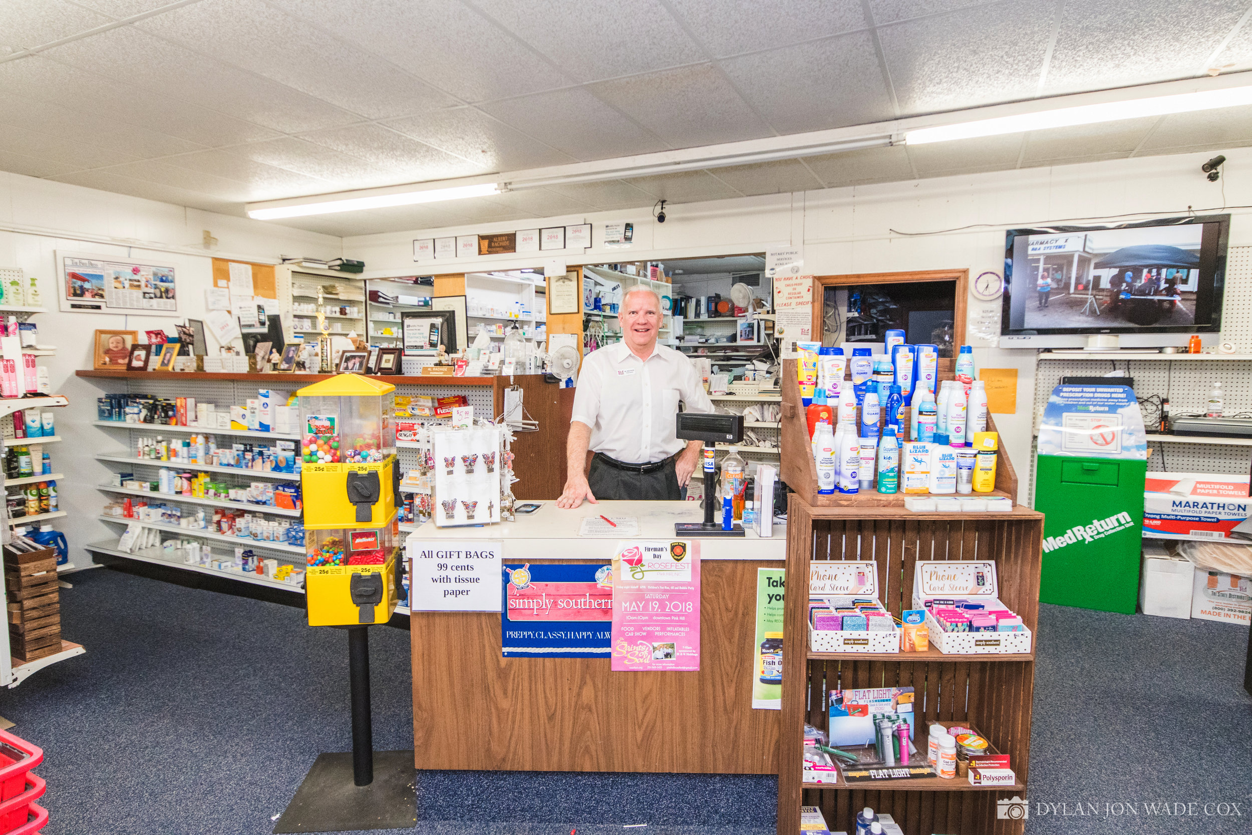 Al Rachide at the Pink Hill Pharmacy counter. Photo by Dylan Jon Wade Cox.
