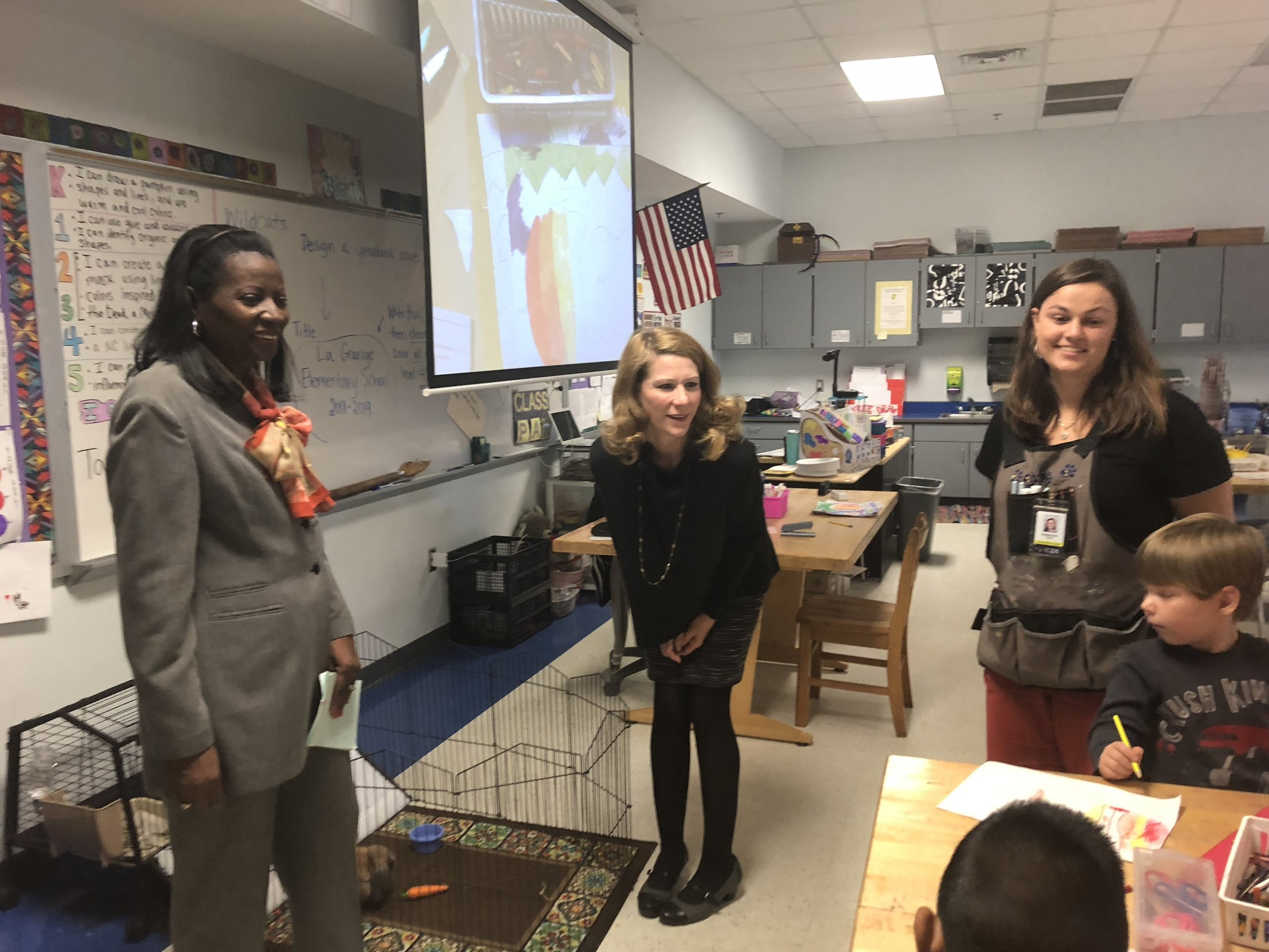 The first lady meets the classroom pet. Photo by Catherine Hardee/Neuse News