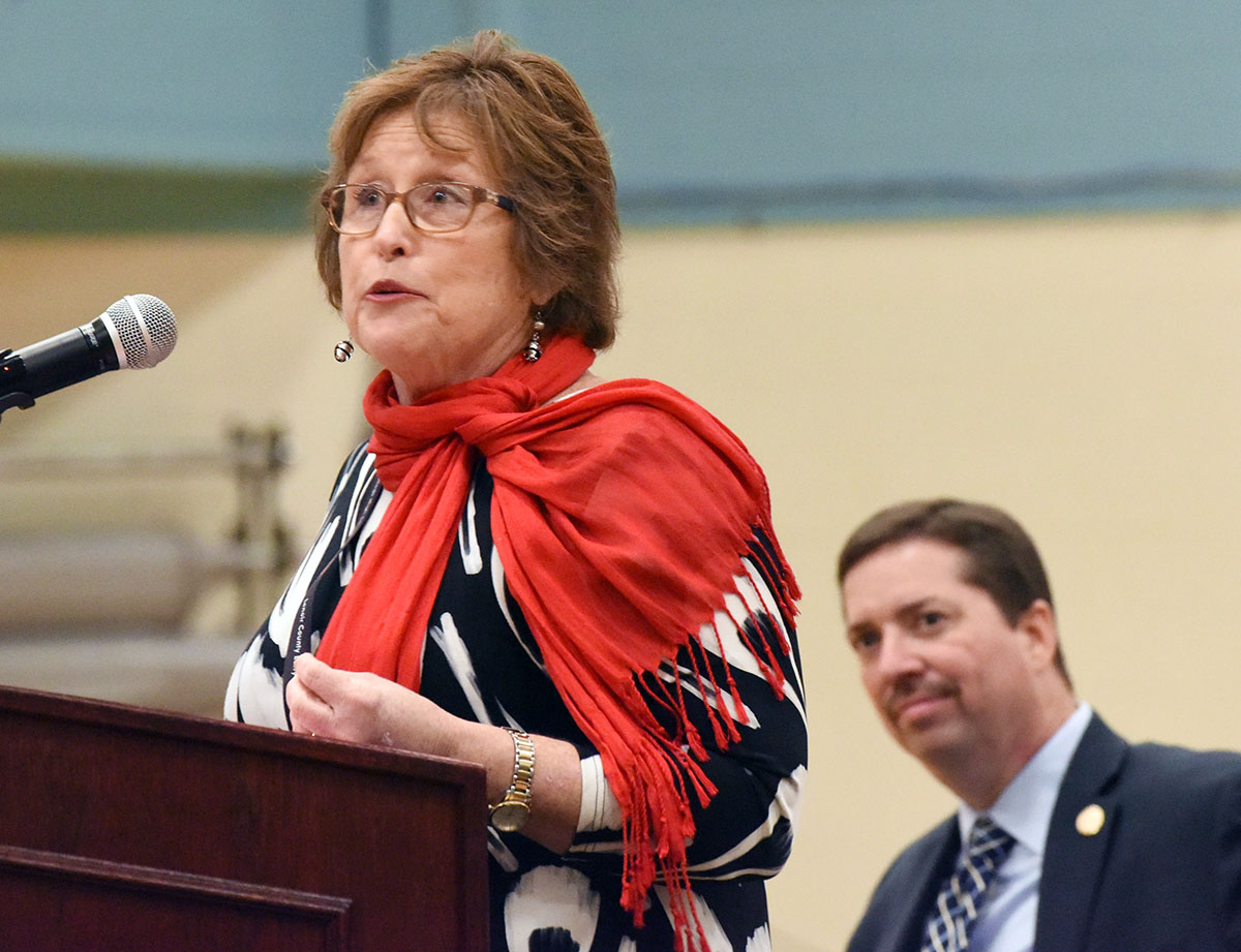 Diane Heath, principal of Lenoir County Early College High School, praises the unity of 'the Phoenix family' during Friday's program. At right is LCPS Superintendent Brent Williams, also a program speaker.