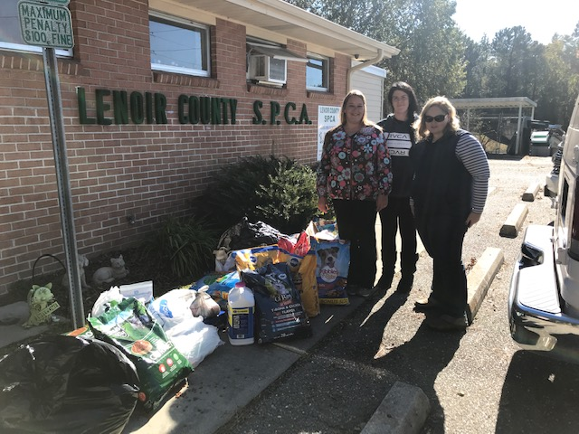 Pictured here is SPCA staff accepting the donations from Martin 4-H County 4-H Agent.