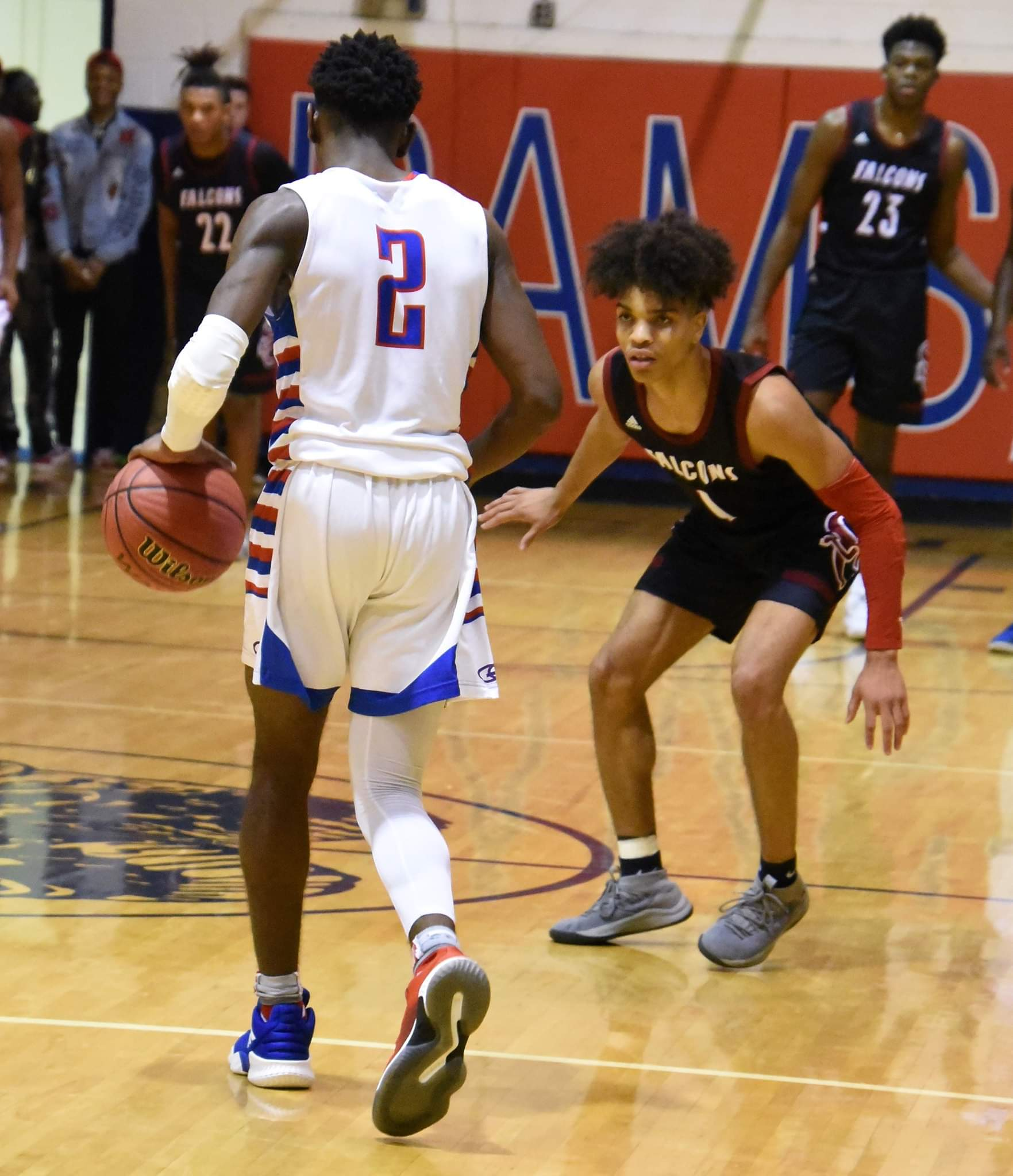 """South Central's Shykeim Phillips defends Greene Central's Hyssan Hudson during Tuesday's game. Photo by William """"Bud"""" Hardy / Neuse News"""