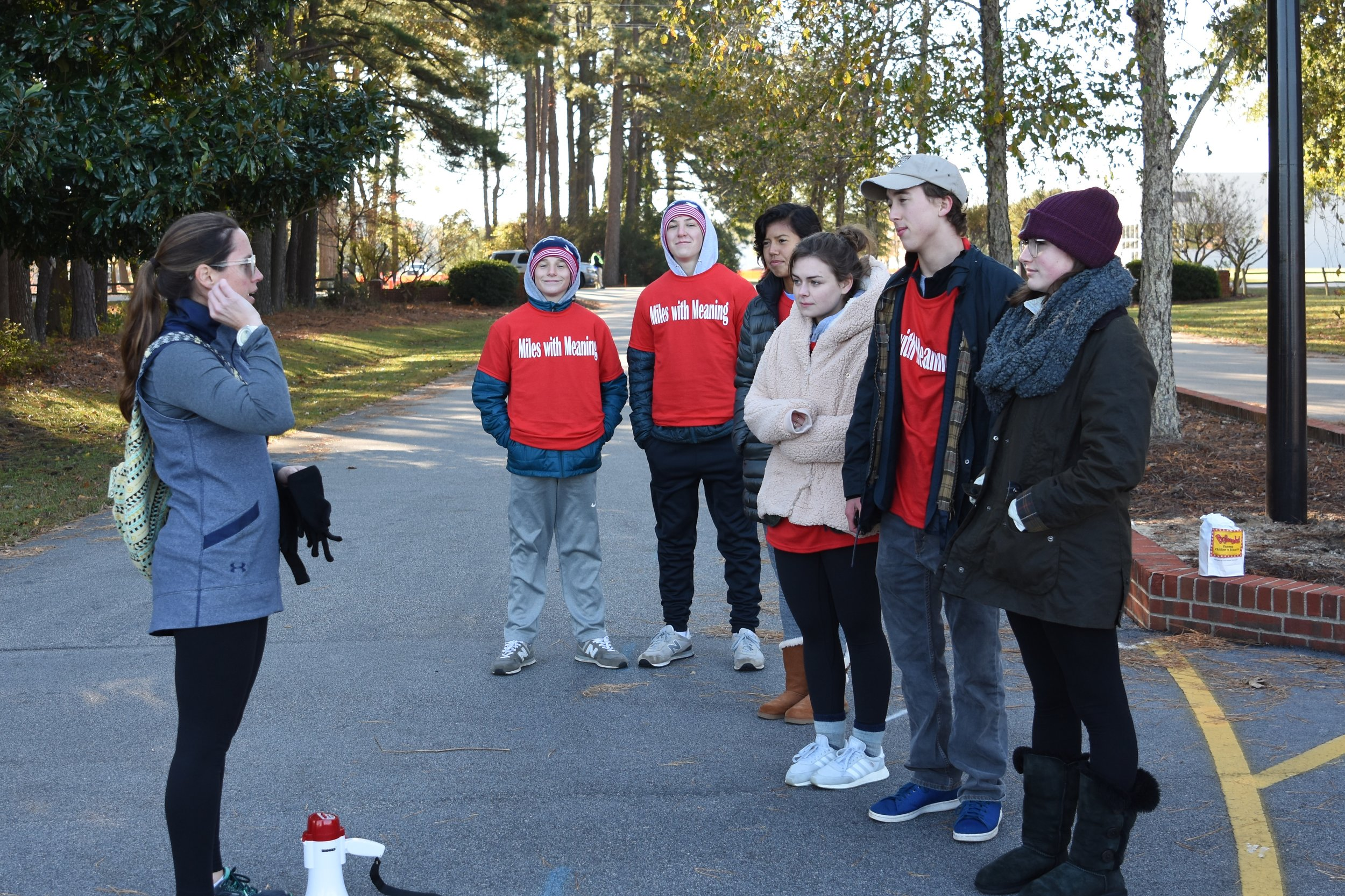 Photo caption: APA teacher and race coordinator Leslie Lewis deploys student volunteers, from left, Matt Wheelis, Morgan McPhaul, Erika Gorrin-Rivas, Sybil Sides, Jeff Bland, and Drew Dacey.