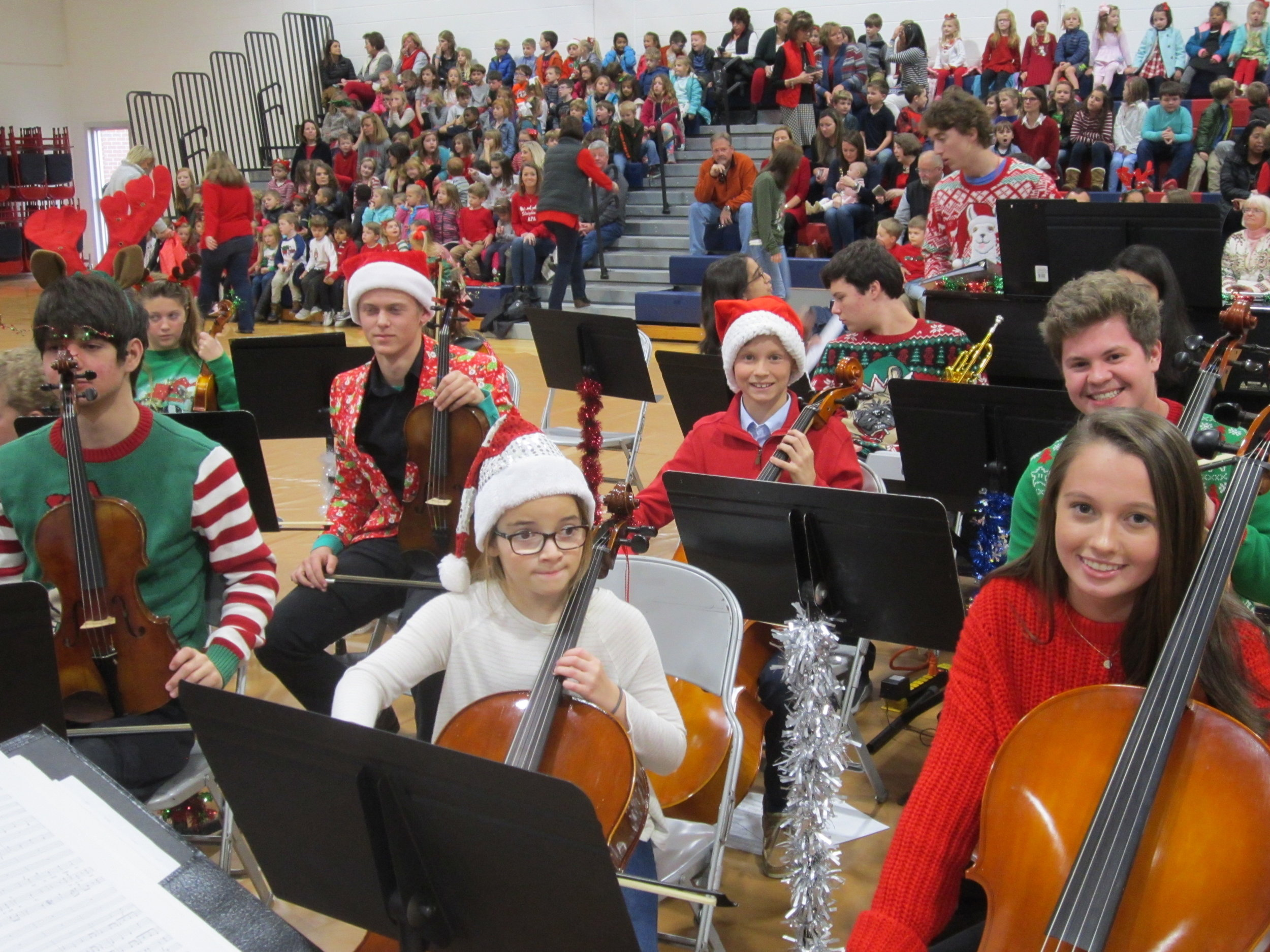 Reindeer antlers and Santa hats jolly up the APA student orchestra for its Holiday Concert performance.