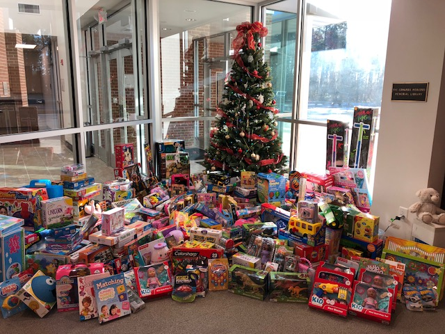 A picture of generosity: Parrott Academy's Christmas tree towers over a flood of donated toys.