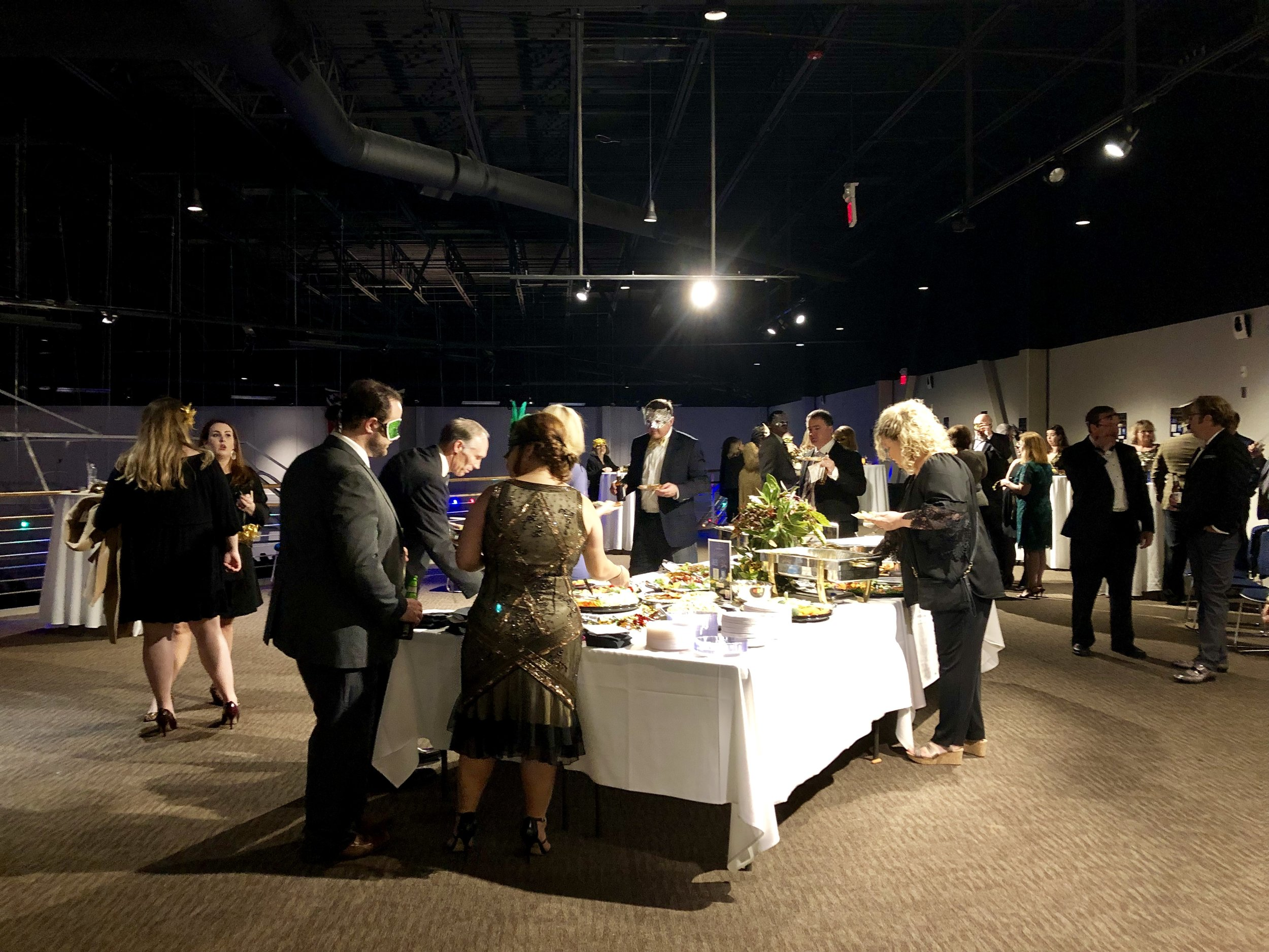 Guests select hors d'oeuvres at the NYE Masquerade.  Photo by Catherine Hardee/Neuse News