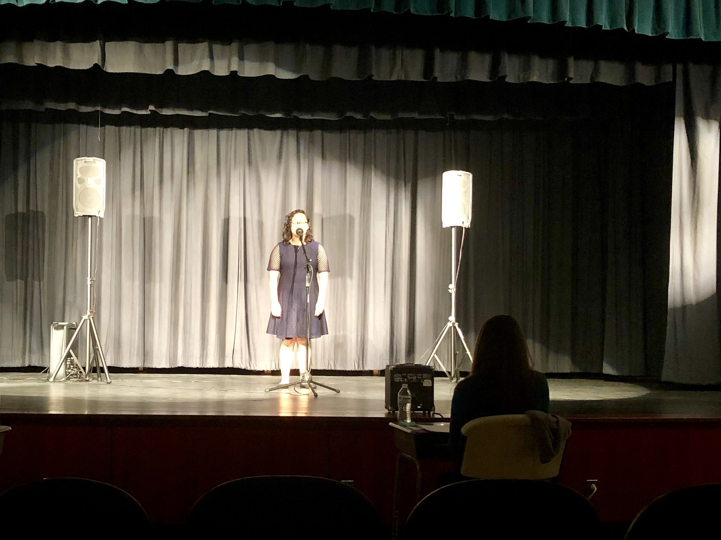 """Anahi Zapata recites """"Be Music, Night"""" by Kenneth Patchen. Photo by Catherine Hardee / Neuse News"""