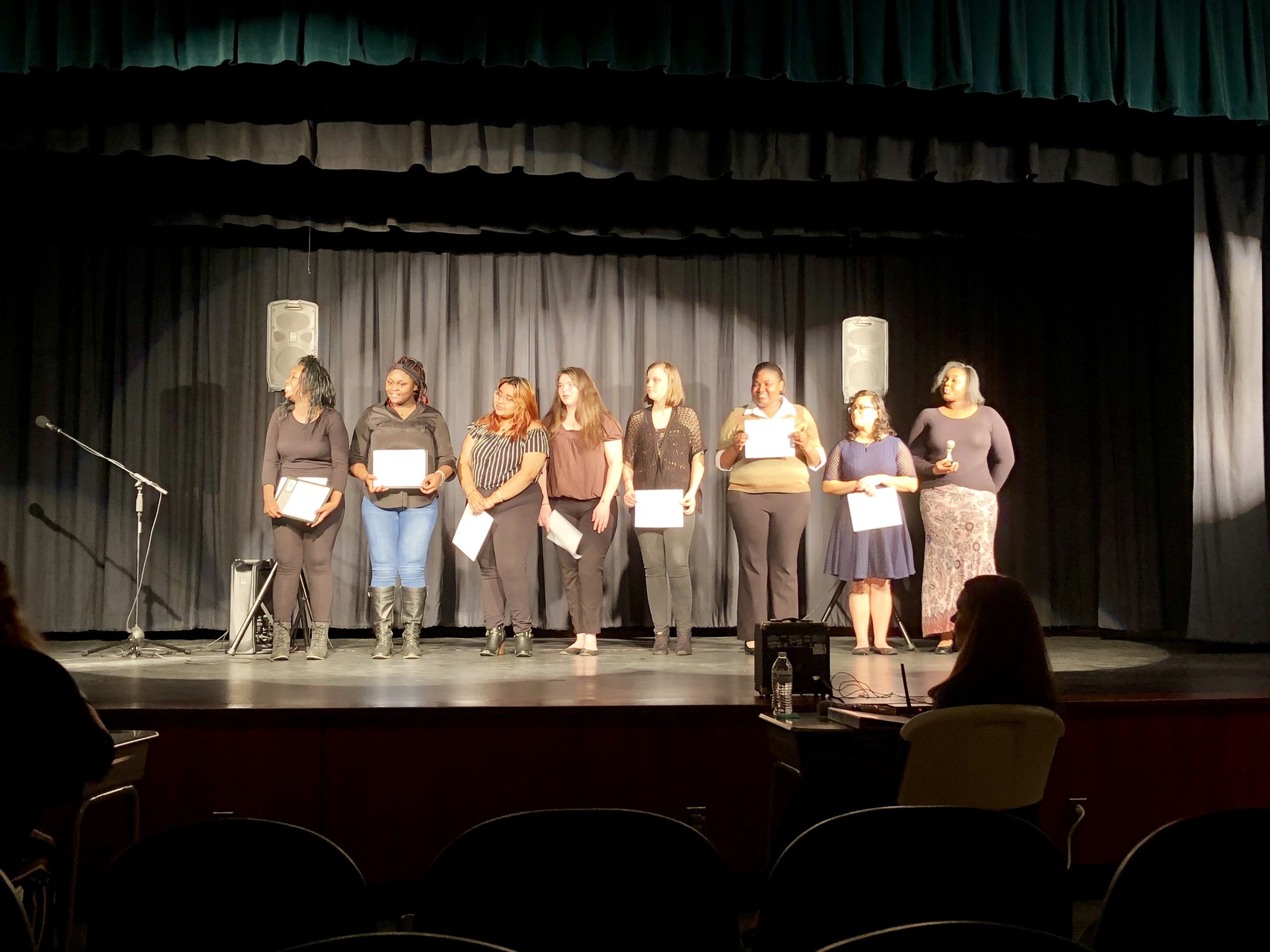 Poetry Out Loud competitors: L-R, Aaliyah Moore, Samantha Newton, Wendy Luviano, Hailey Braxton, Ashley Hood, Evelyn Allen, Anahi Zapata, Nyashia Sutton.  Photo by Catherine Hardee / Neuse News