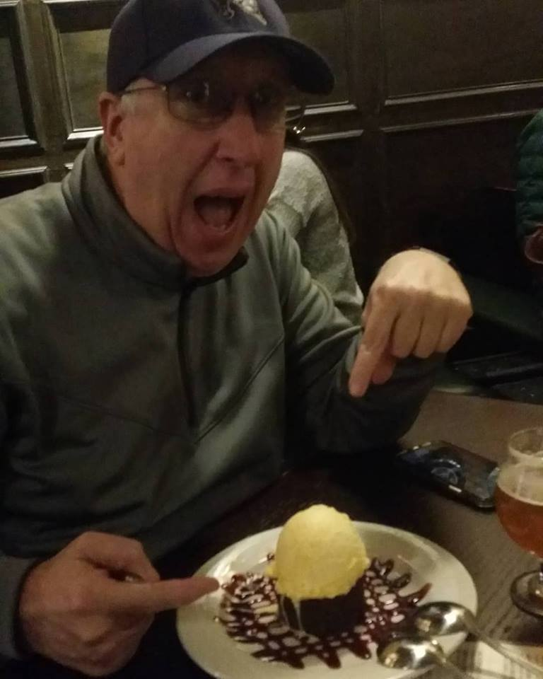 Bryan Hanks asks waitress which end of the spoon he's supposed to use / Photo by Jon Dawson - Neuse News