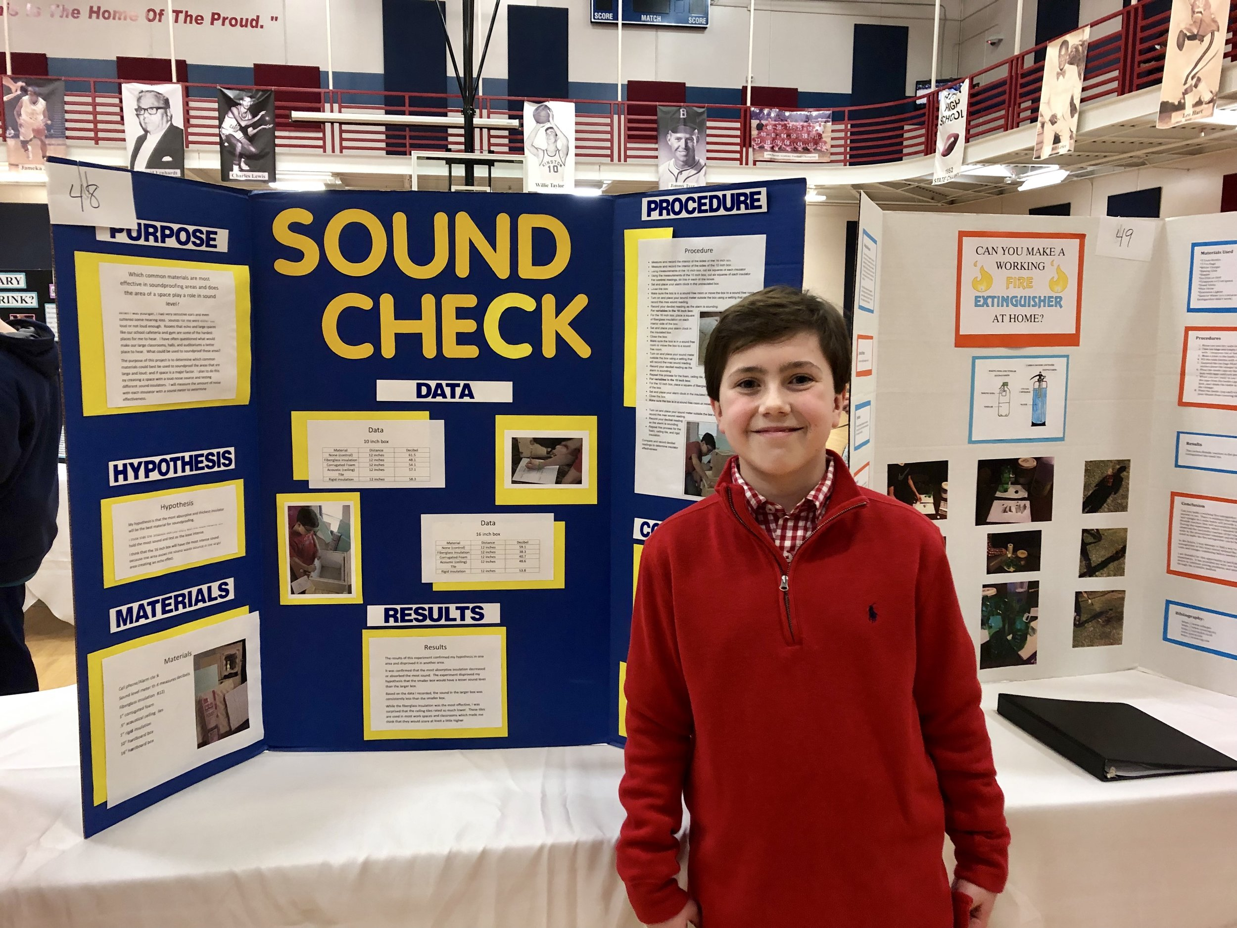 E. B. Frink seventh-grader Austin Williams with his project on the sound-proofing capabilities of different materials. Photo by Catherine Hardee/Neuse News