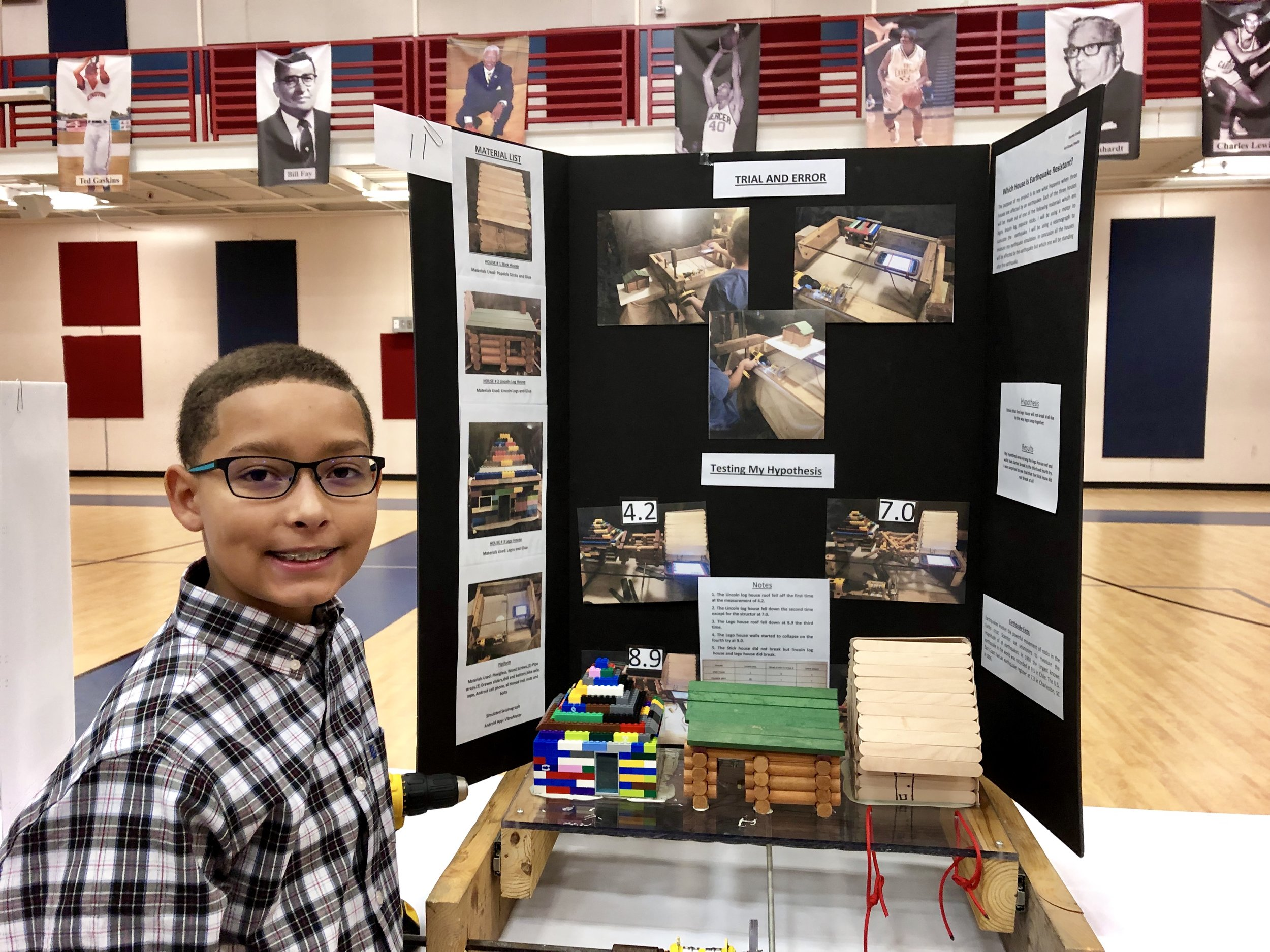 Contentnea-Savannah fourth-grader Brooks Grady with his simulated earthquake project. Photo by Catherine Hardee/Neuse News