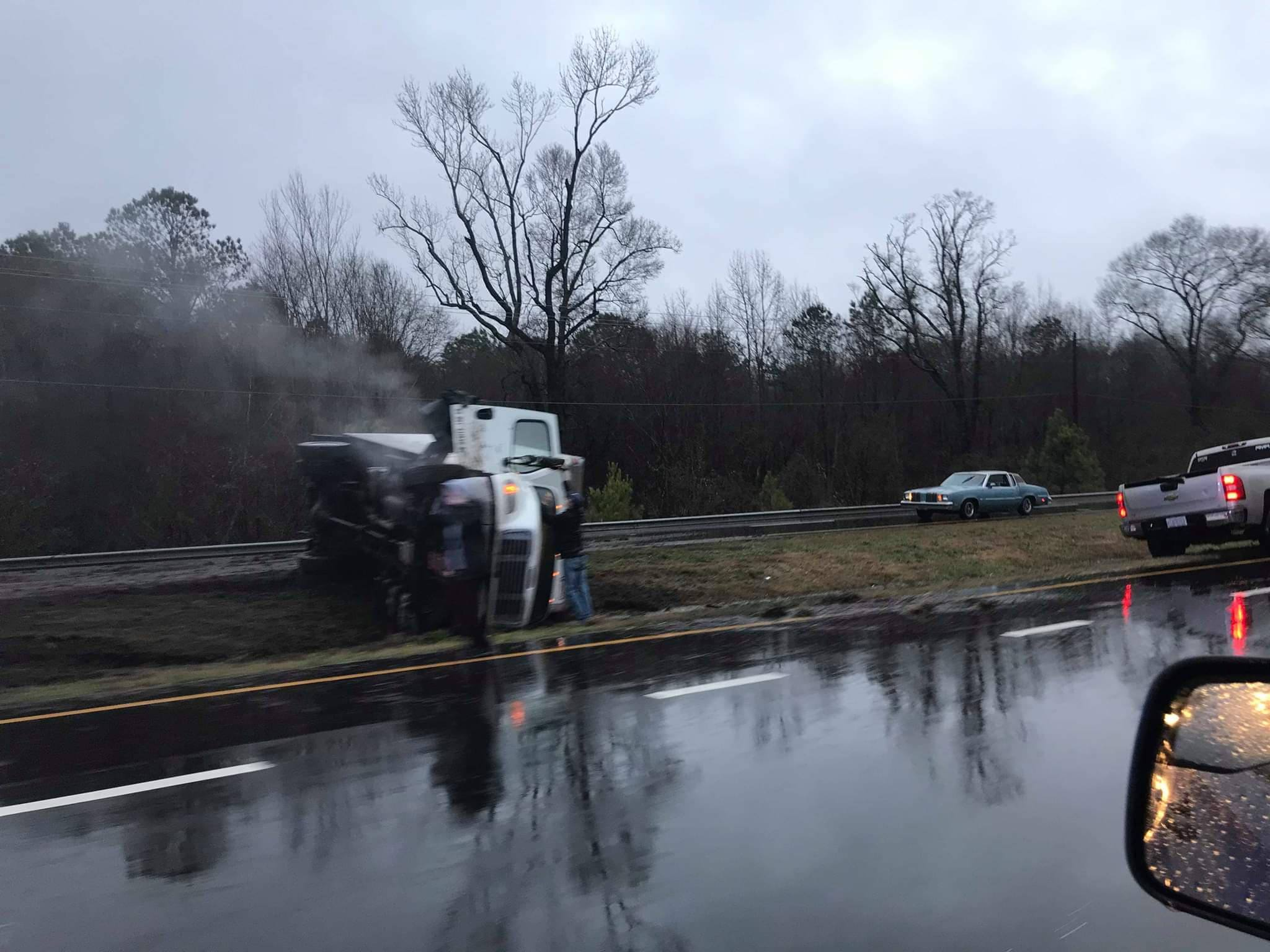 Box truck overturned on highway 70 near Davis Tire in Kinston. Submitted photo by member of  WeReportNeuseNews.com .