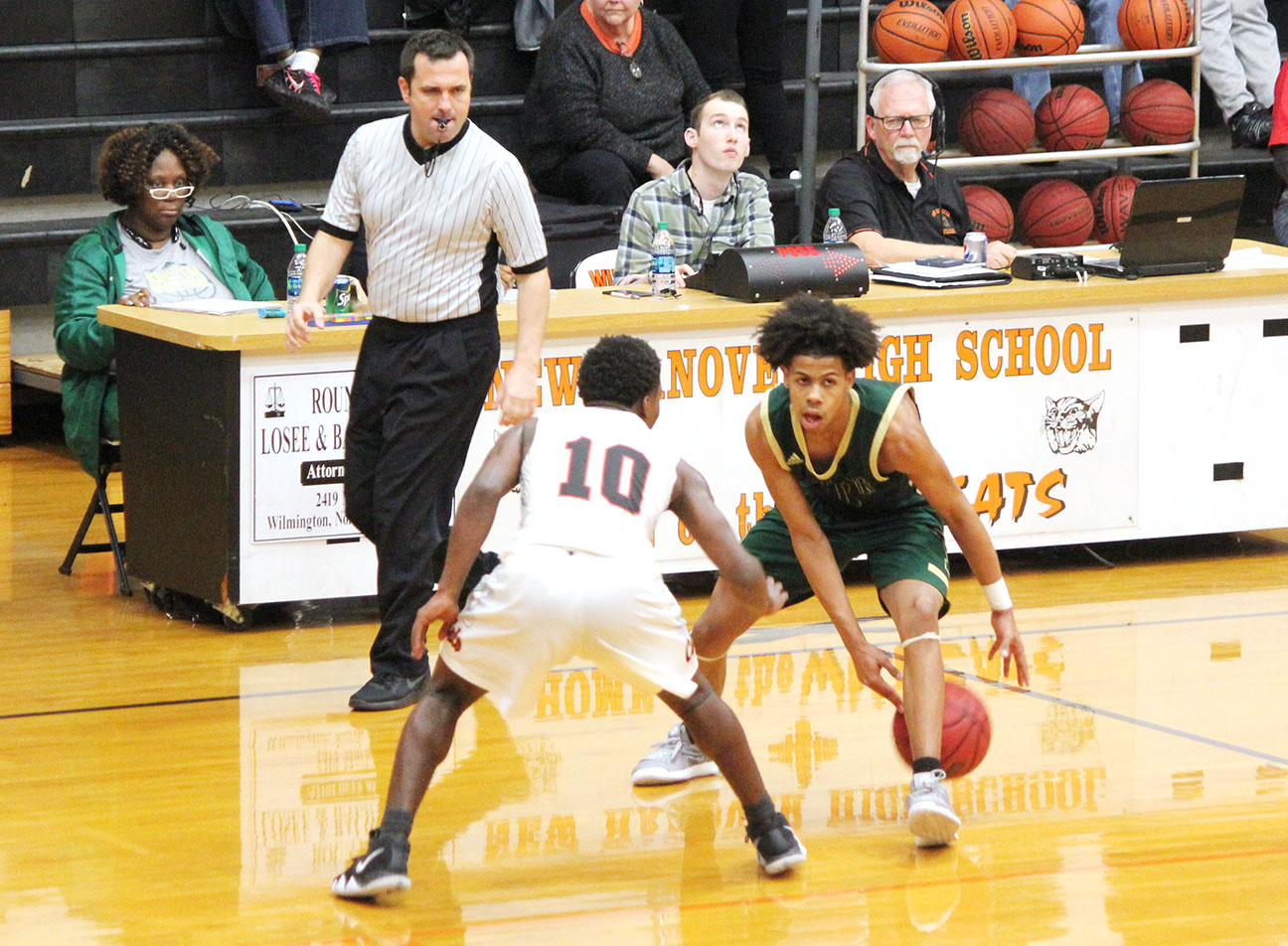 Kinston junior point guard Isaac Parson goes between his legs against