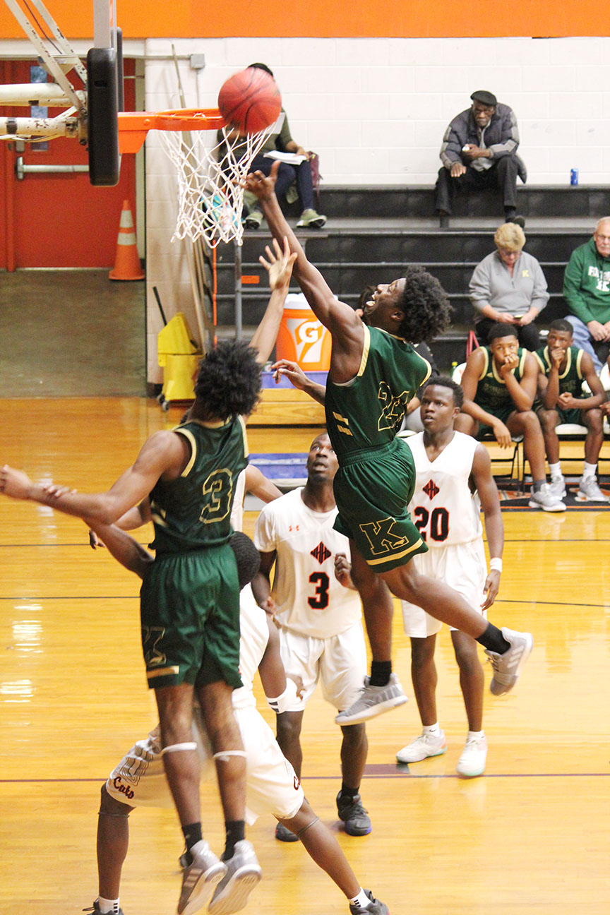 Kinston's Will London (24) and Dontrez Styles (3) battle against Wilmington New Hanover in the second half of Saturday's game. Photo by Linda Whittington / Neuse News
