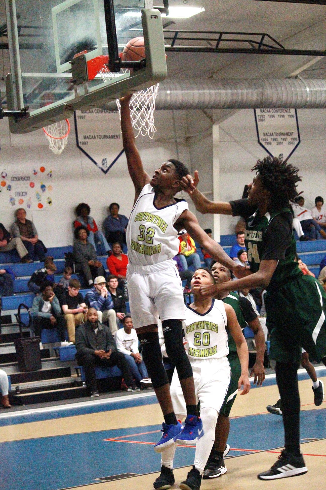 Contentnea-Savannah School's Tre'Shad Lynch rises high for two of his game-high 13 points in the boys' championship game. Photo by Linda Whittington / Neuse News