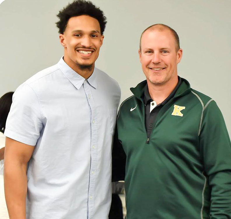 Derek Rivers poses for a photo with Kinston High School assistant football coach Tom Vermillion during an FCA event in Kinston in May. Photo by William 'Bud' Hardy / Neuse News