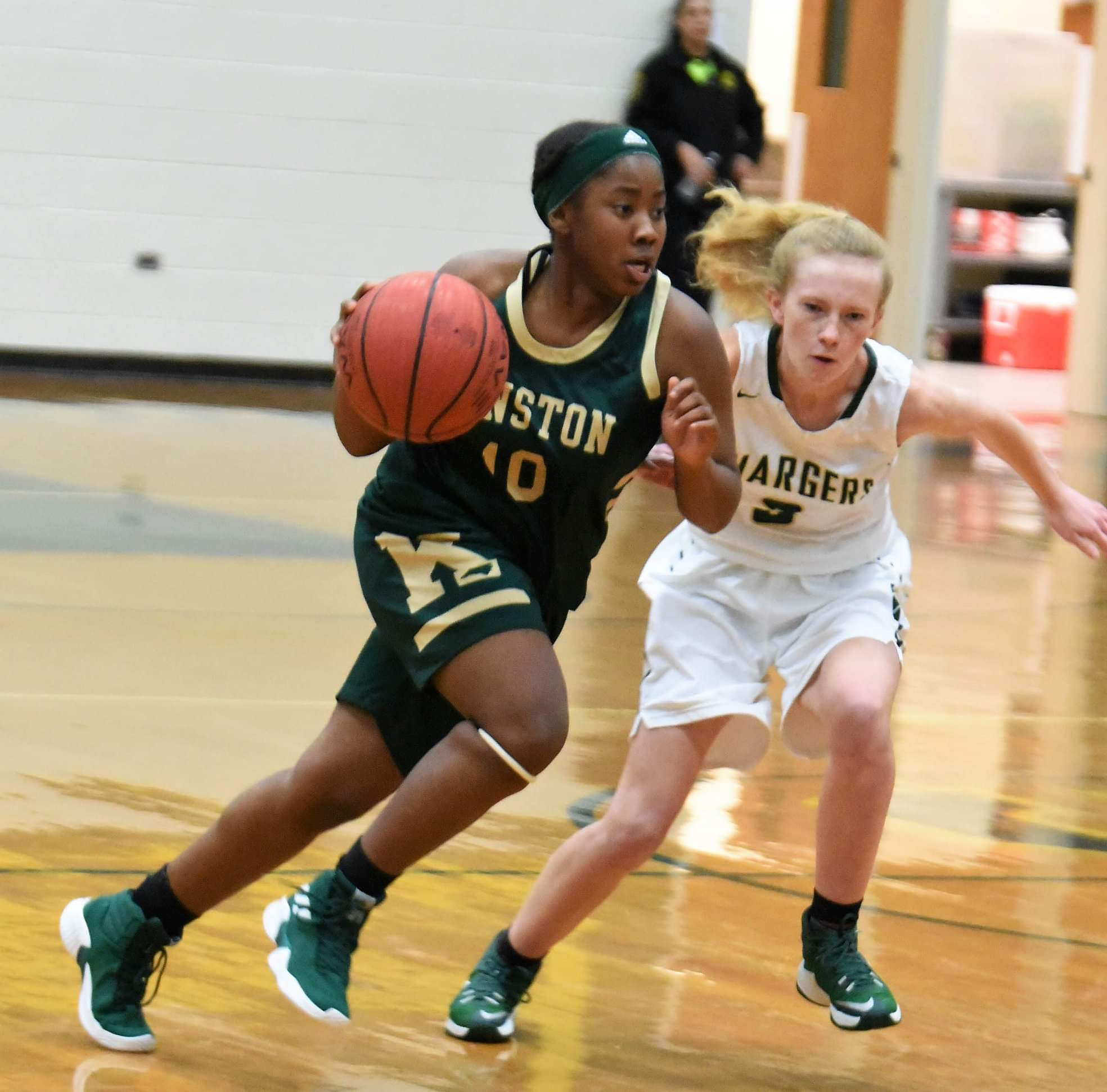"""Kinston's Samantha Lee looks to drive past Ayden-Grifton's Kristen Hardee in Tuesday's contest. Photo by William """"Bud"""" Hardy / Neuse News"""