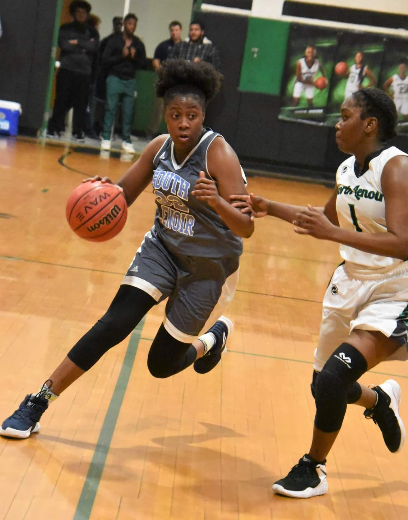 "South Lenoir's Gralicia Jenkins drives against the defense of North Lenoir's Emmenia Lynch during Wednesday's contest. Photo by William ""Bud"" Hardy / Neuse News"
