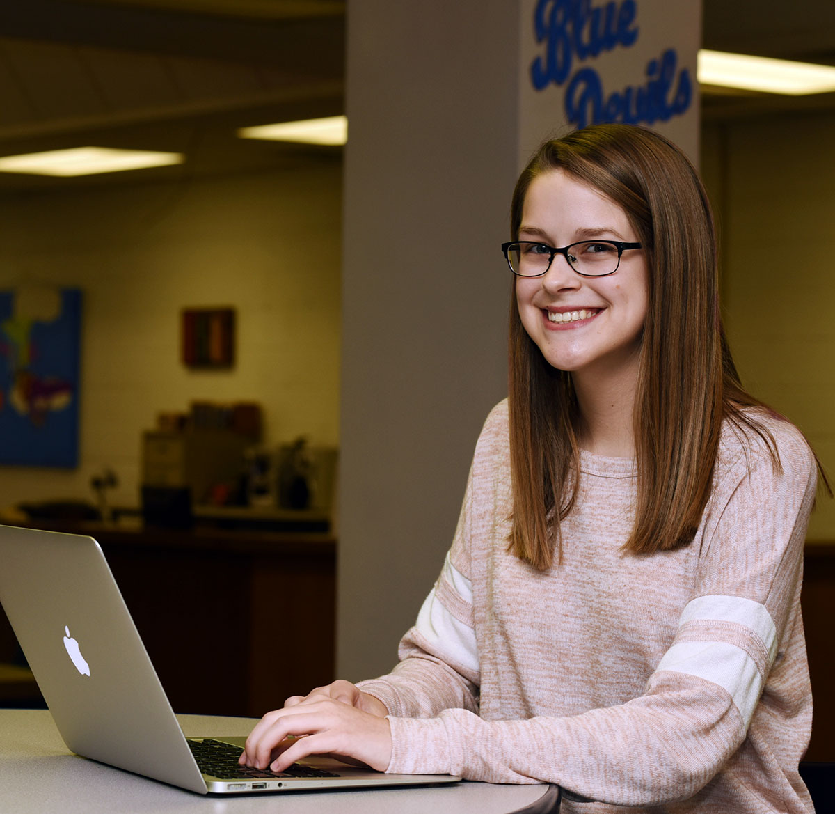 Ashlynn Holloman, a sophomore at South Lenoir High School, aspires to be a middle school math teacher and sees the similarities between coding and math. 'It's logical,' she says. Photo by Patrick Holmes / LCPS