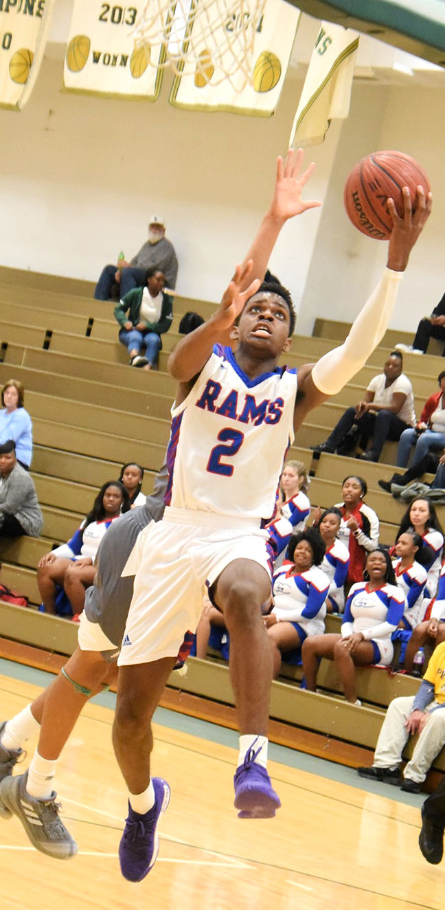 Greene Central's Hysaan Hudson (2) drives past the Ayden-Grifton defense for two of his 12 points in Wednesday's game. Photo by William 'Bud' Hardy / Neuse News