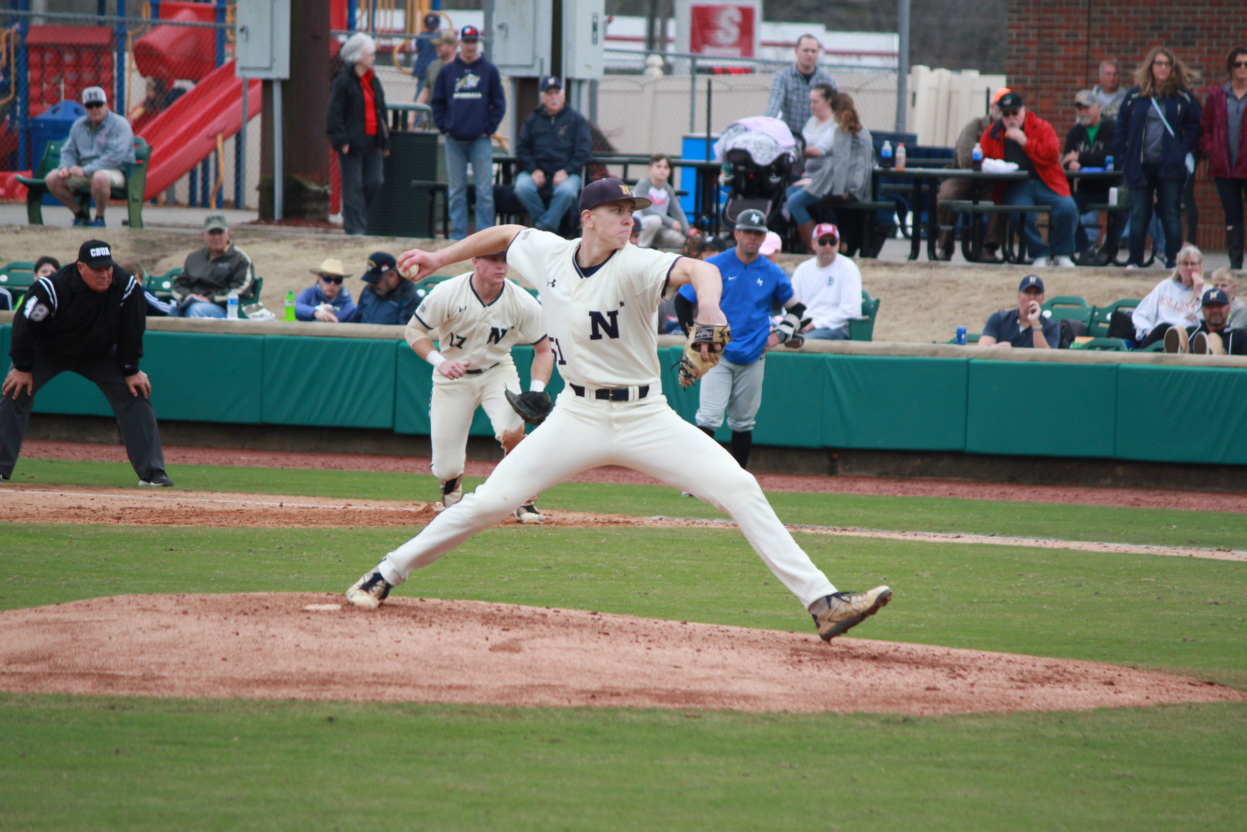 Navy sophomore pitcher Jared Leins (51), Sunday's Game 1 starter, prepares to deliver a pitch. Photo by Linda Whittington / Neuse News