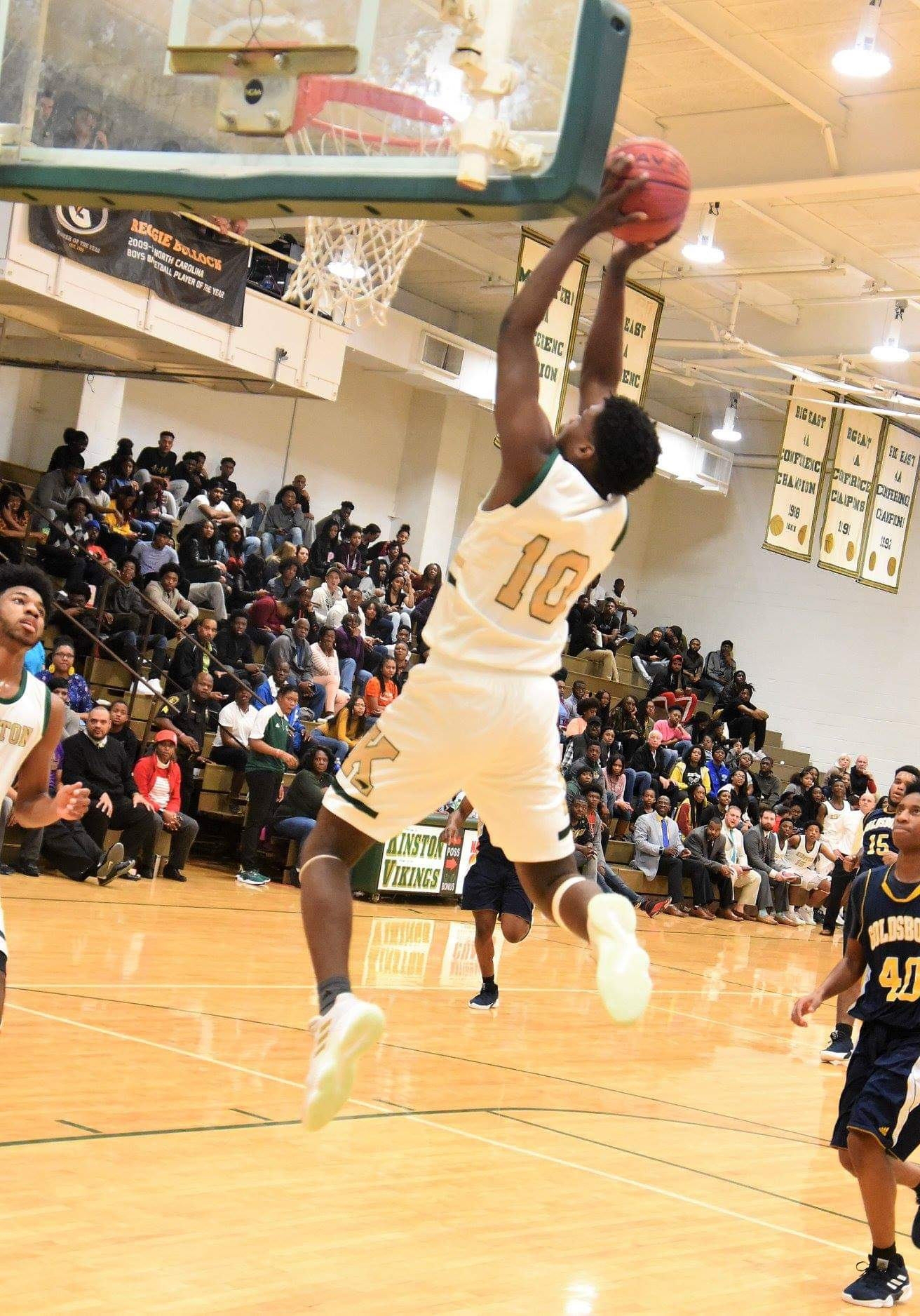 "Kinston's Judah McBynum skies for a basket in Kinston's game against Goldsboro Dec. 20, 2018. Photo by William ""Bud"" Hardy"