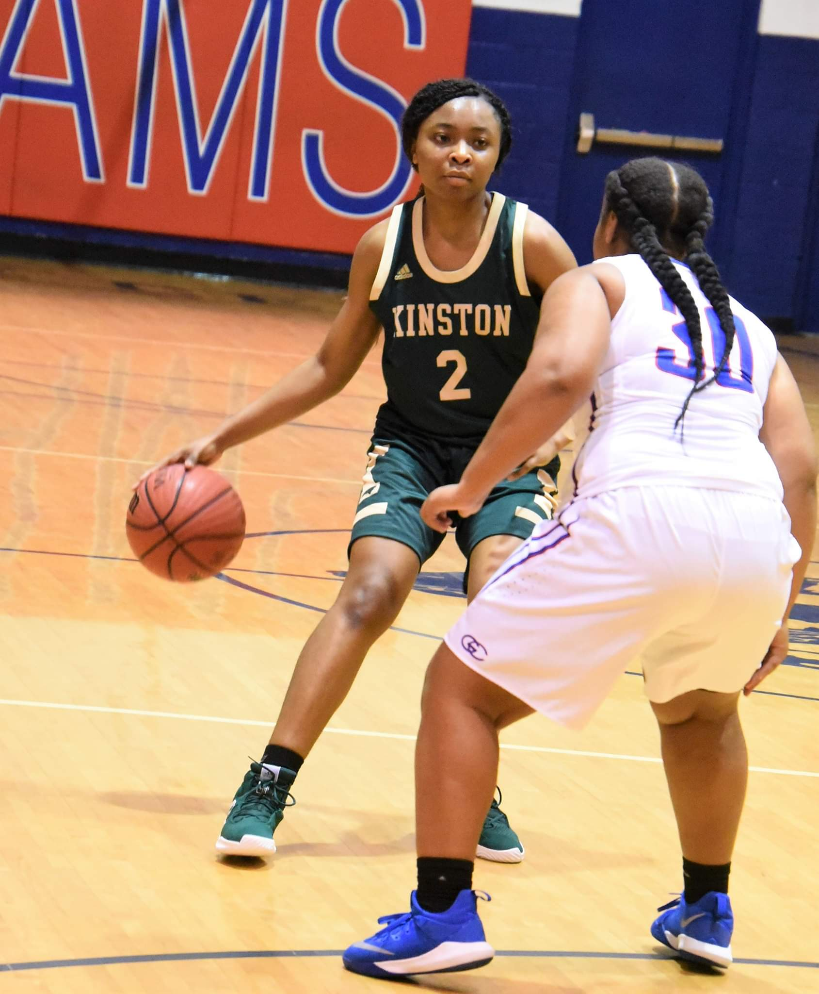 "Kinston's Khalia Hargett looks to make a play while being defended against Greene Central's Leaudrea Mason during a game on Dec. 14, 2018. Photo by William ""Bud"" Hardy"