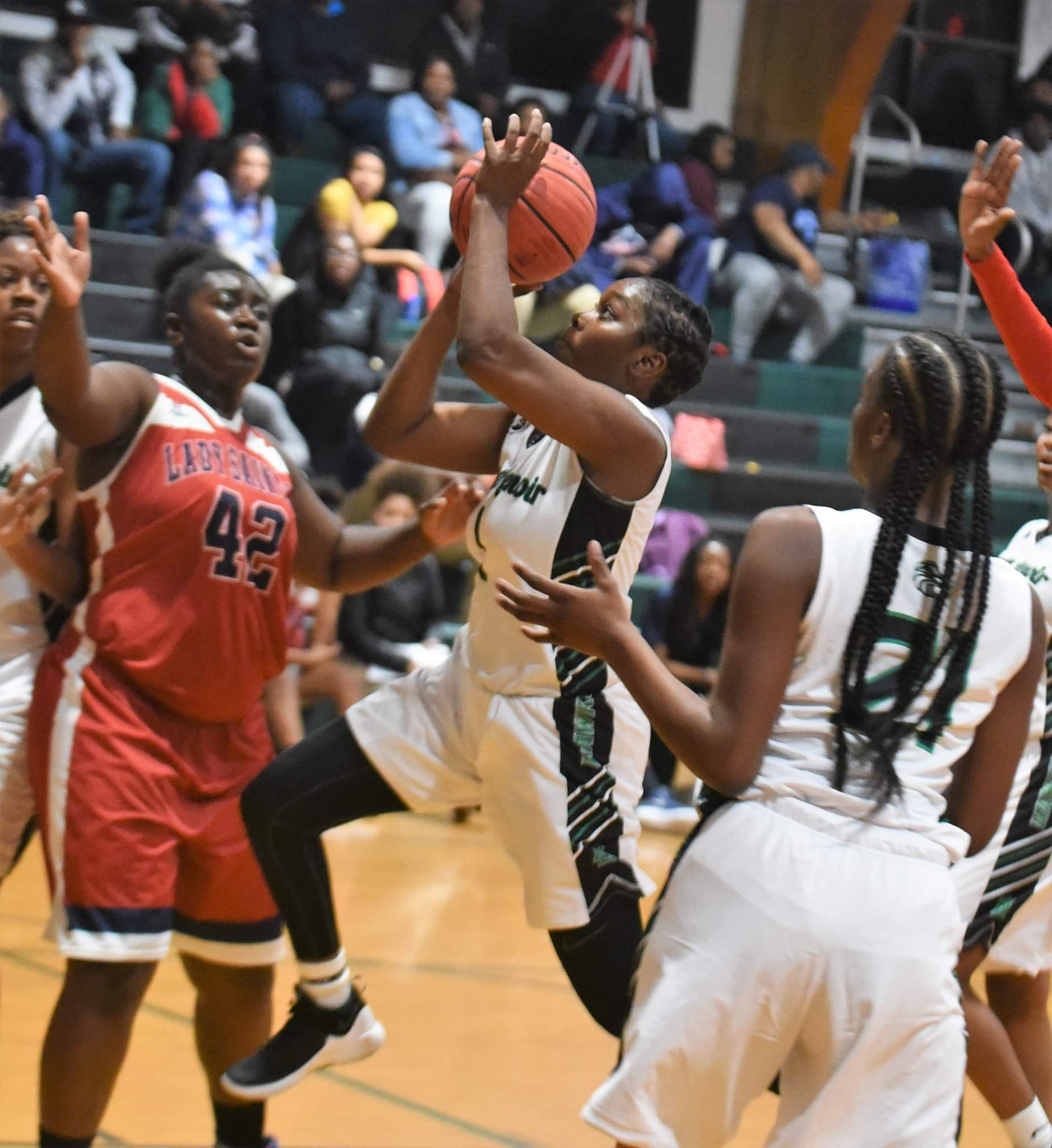 "North Lenoir's Emmenia Lynch drove to the basket against Southern Wayne on Nov. 26, 2018. Photo by William ""Bud"" Hardy"