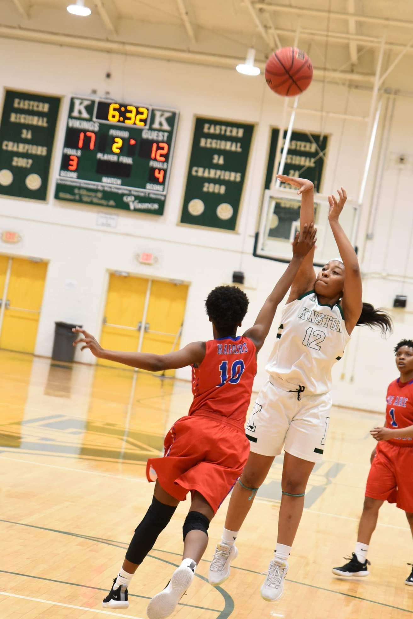 Kinston's Quiaira Powell goes up for a jump shot as High Point Andrews' Anaya Cureton closes out during the third-round playoff game March 2. The Vikings hope to reach their second straight Eastern Regionals with a win over Ledford Senior Tuesday. Photo by William 'Bud' Hardy