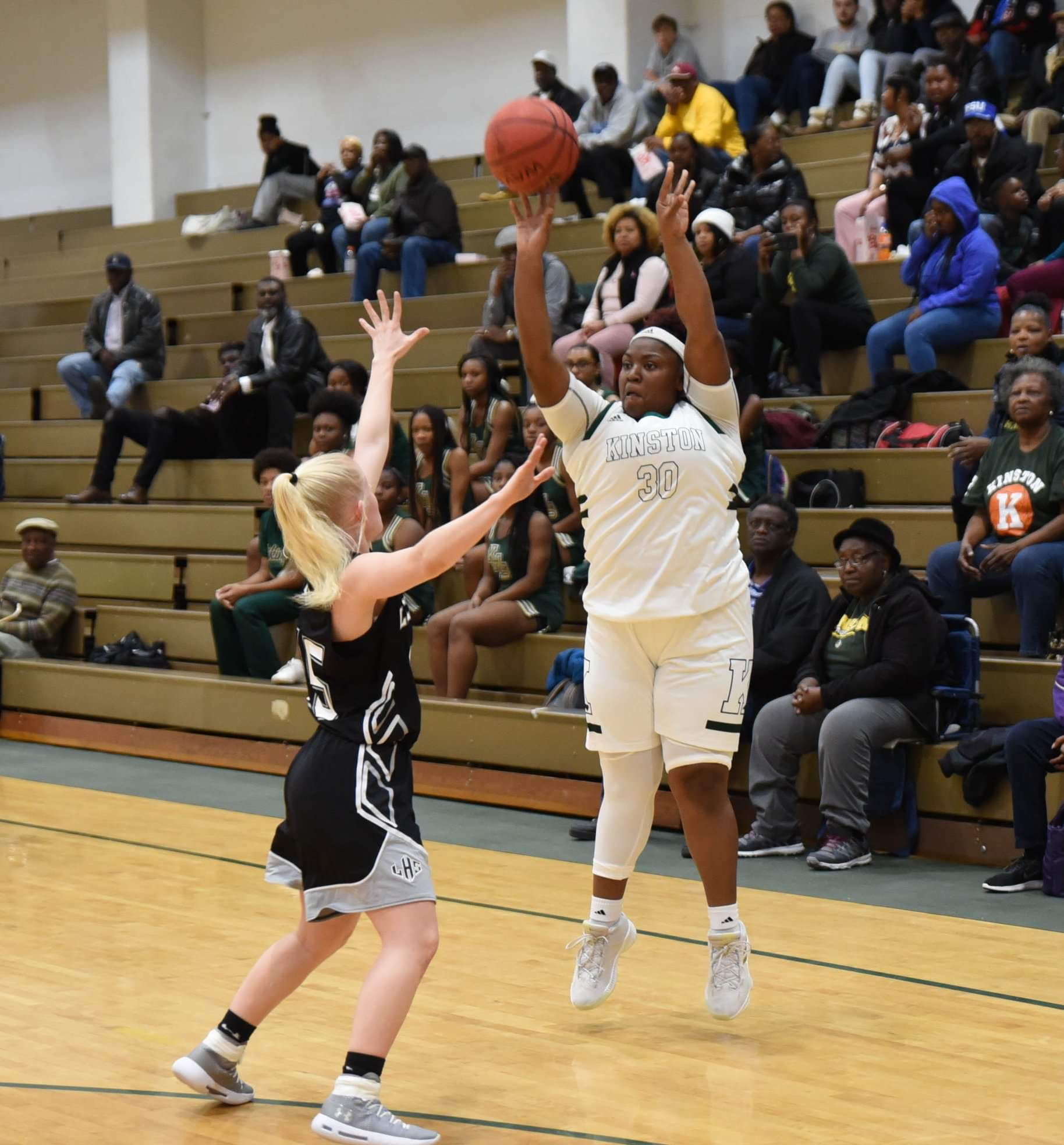 Kinston's Zykia Andrews shoots over Ledford's Allie Davis during Tuesday's fourth-round matchup. Photo by William 'Bud' Hardy / Neuse News