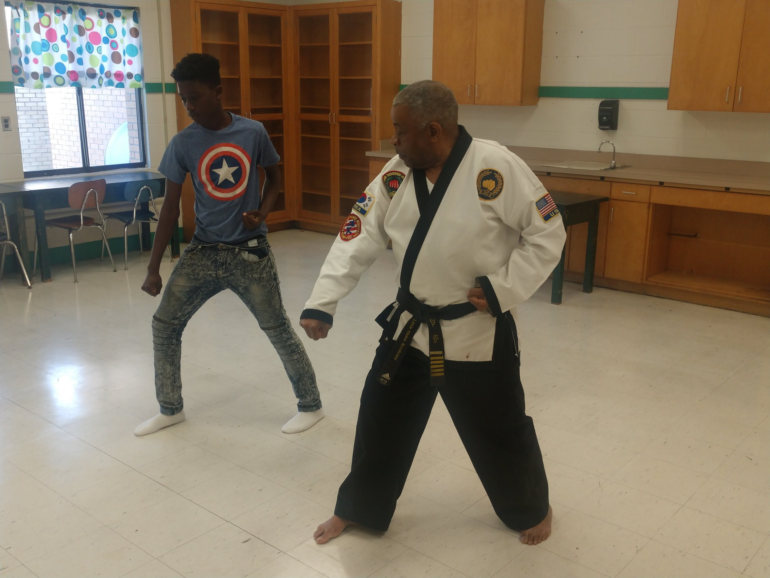 Master Joseph Jones goes over Tae Kwon Do techniques with Rochelle Middle seventh-grader Yazmere Hatch during a class at the school. Photo by Junious Smith III / Neuse News