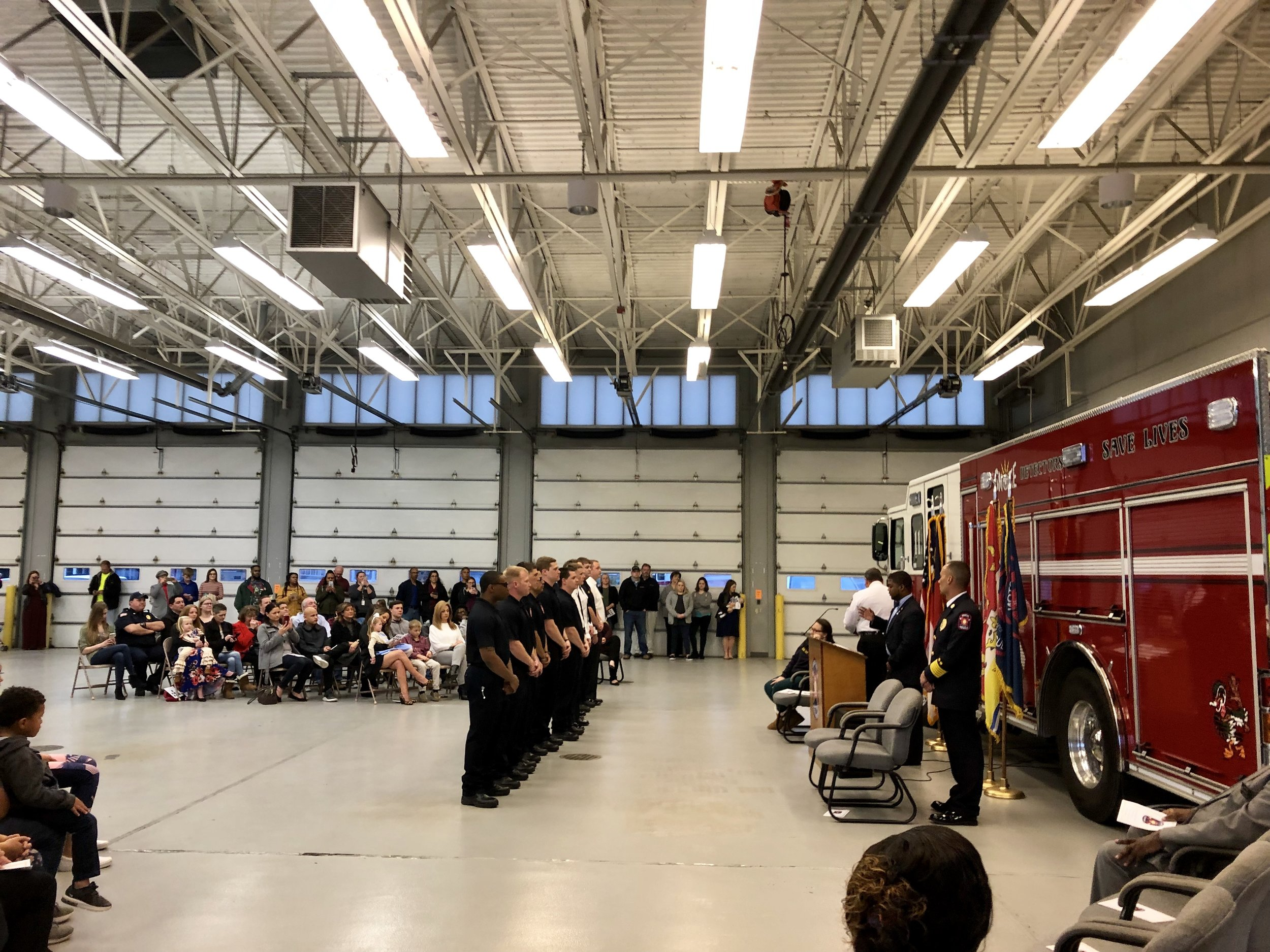 Newly-hired fire fighters are sworn in to the department by Mayor Don Hardy as Chief Locklear looks on. Photo by Catherine Hardee / Neuse News