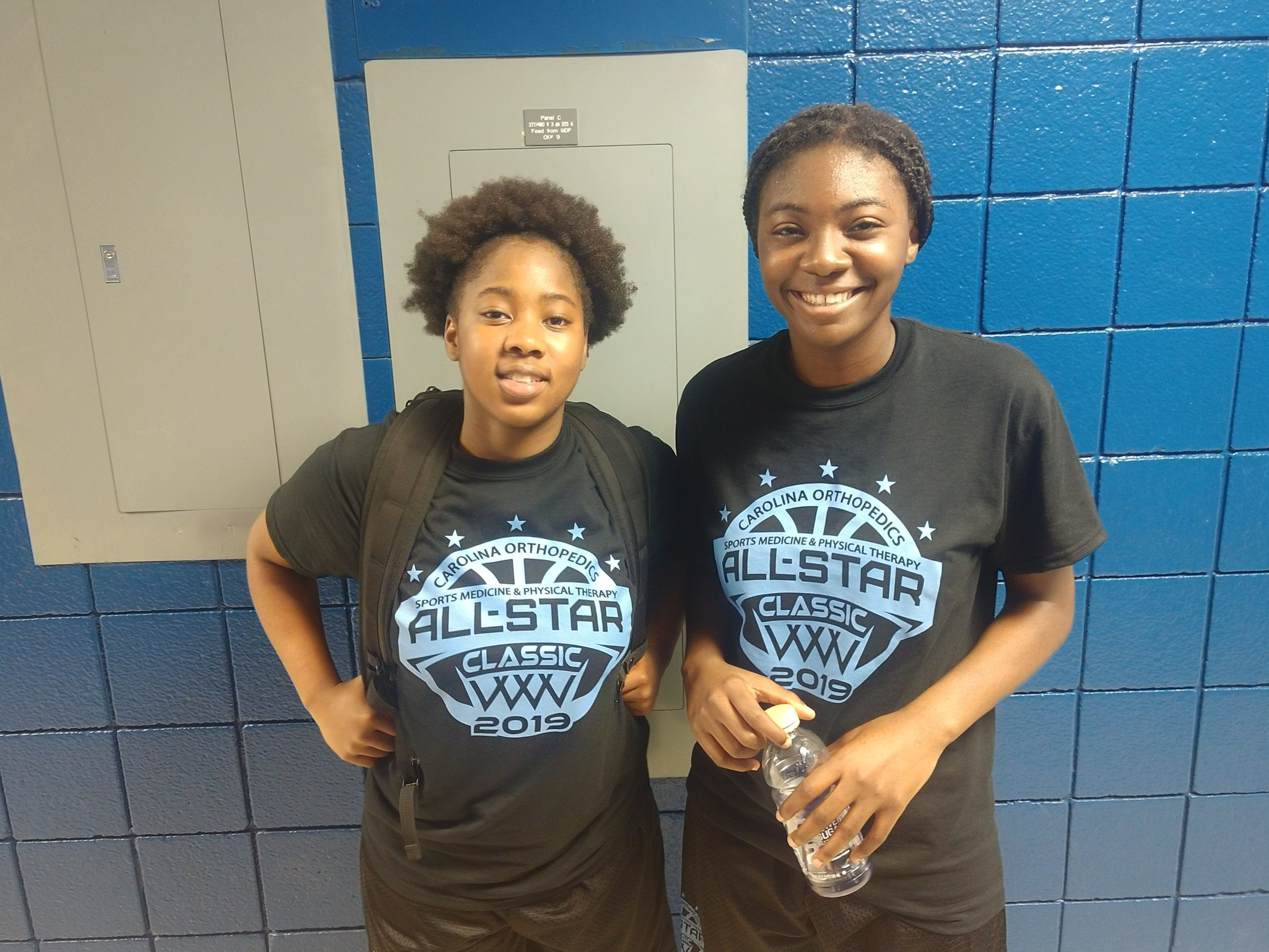 Kinston's Samantha Lee, left and South Lenoir's Taniejah Mitchell wrapped up their storied high school careers in Saturday's Craven County Classic. Photo by Junious Smith III / Neuse News